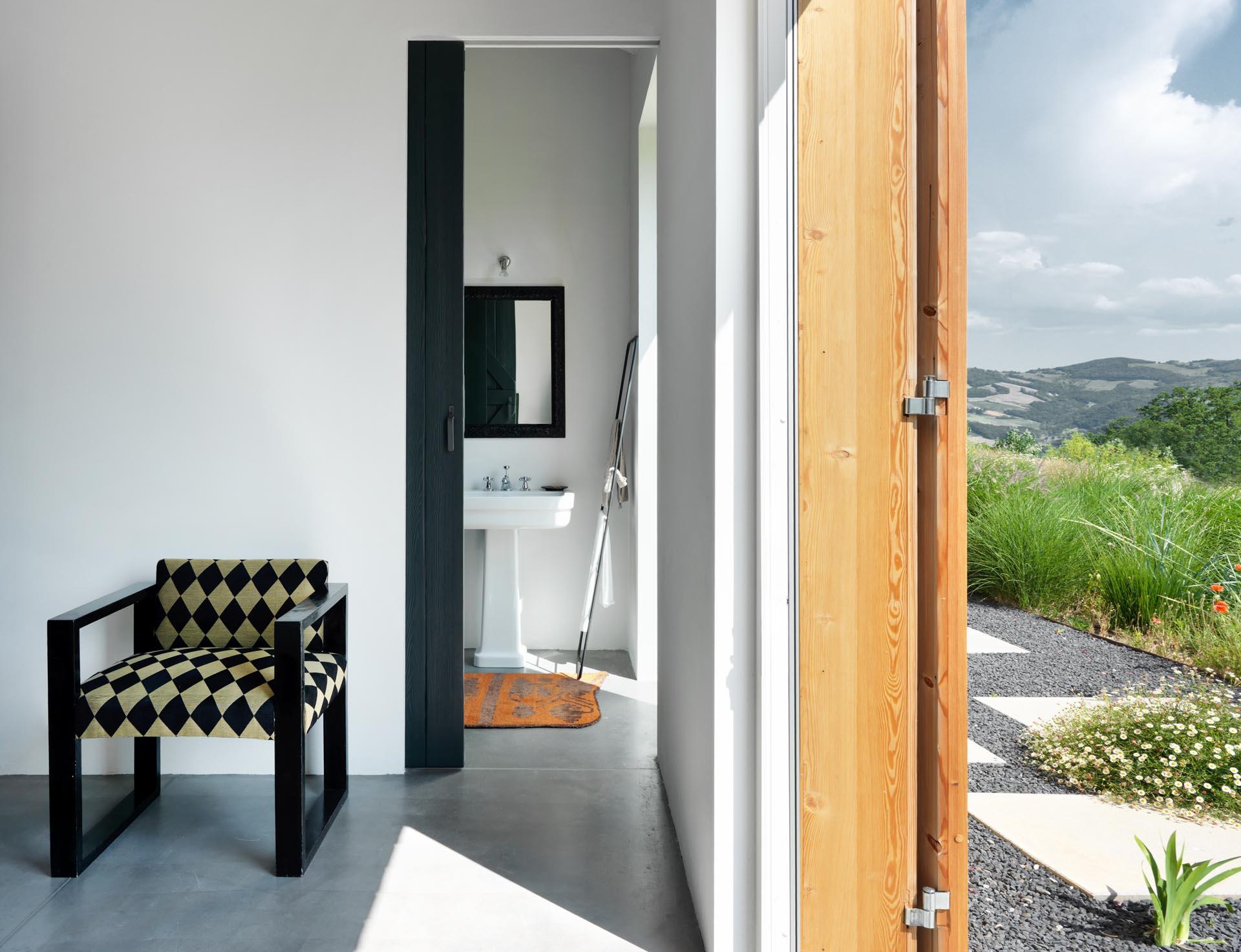An ensuite bathroom with a black sliding door.