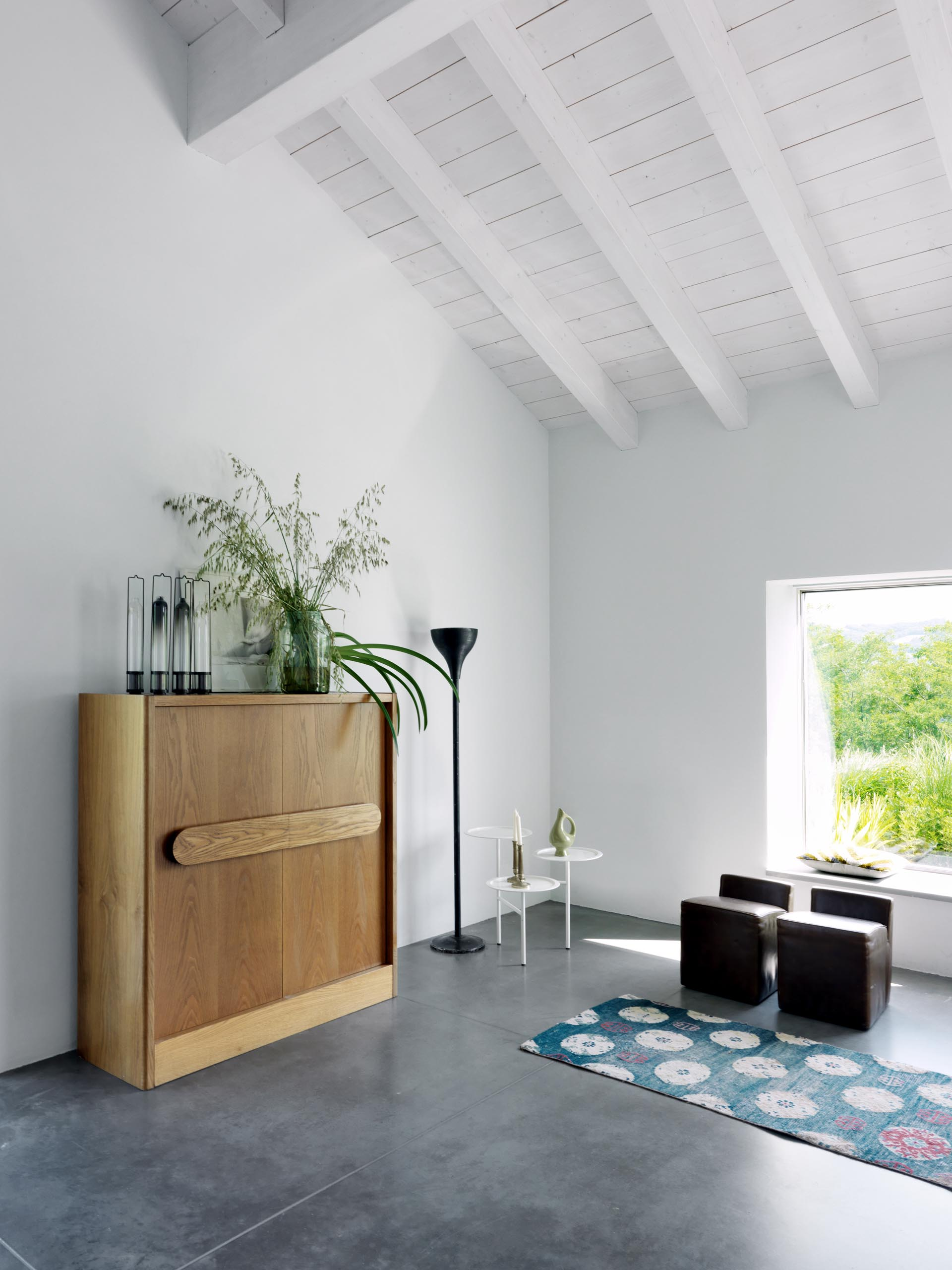 A minimally furnished room in a modern country farmhouse.