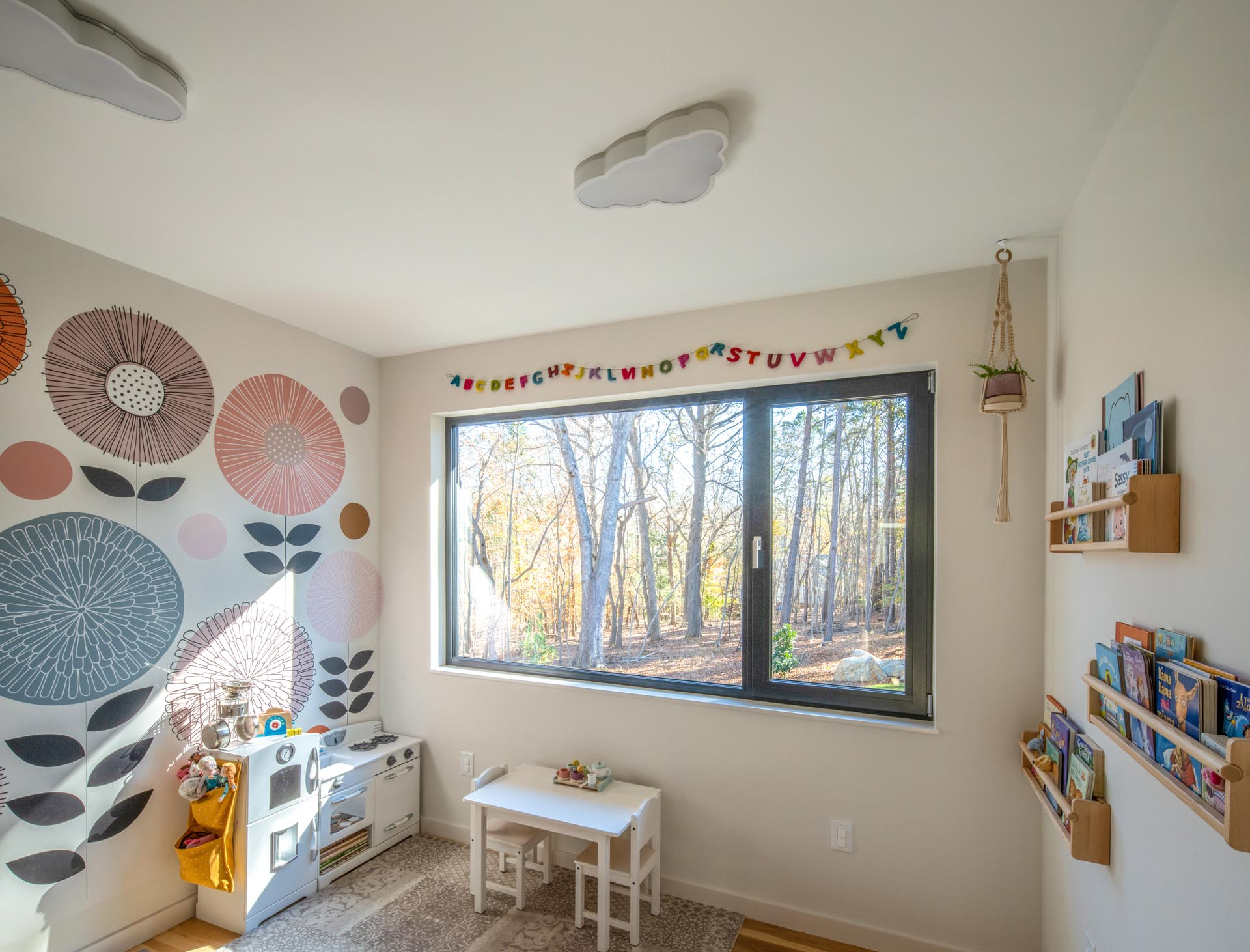 A modern playroom/nursery for the kids that they can each access from their respective bedrooms.