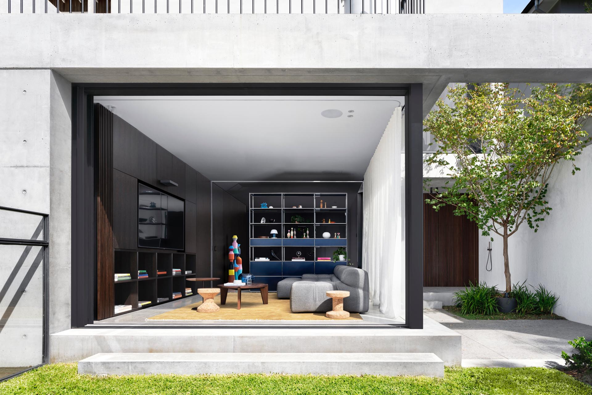 A modern living room open to a small yard.
