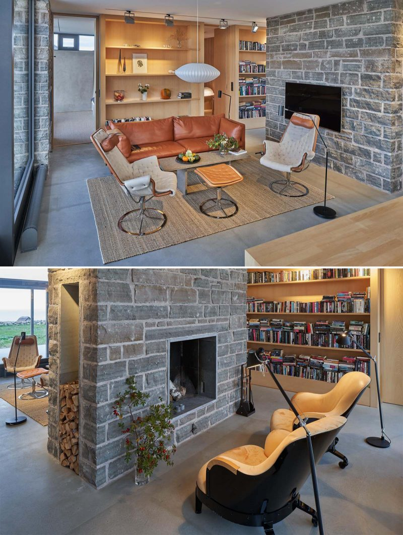 A limestone wall  separates the main living room from a small sitting area with a fireplace.