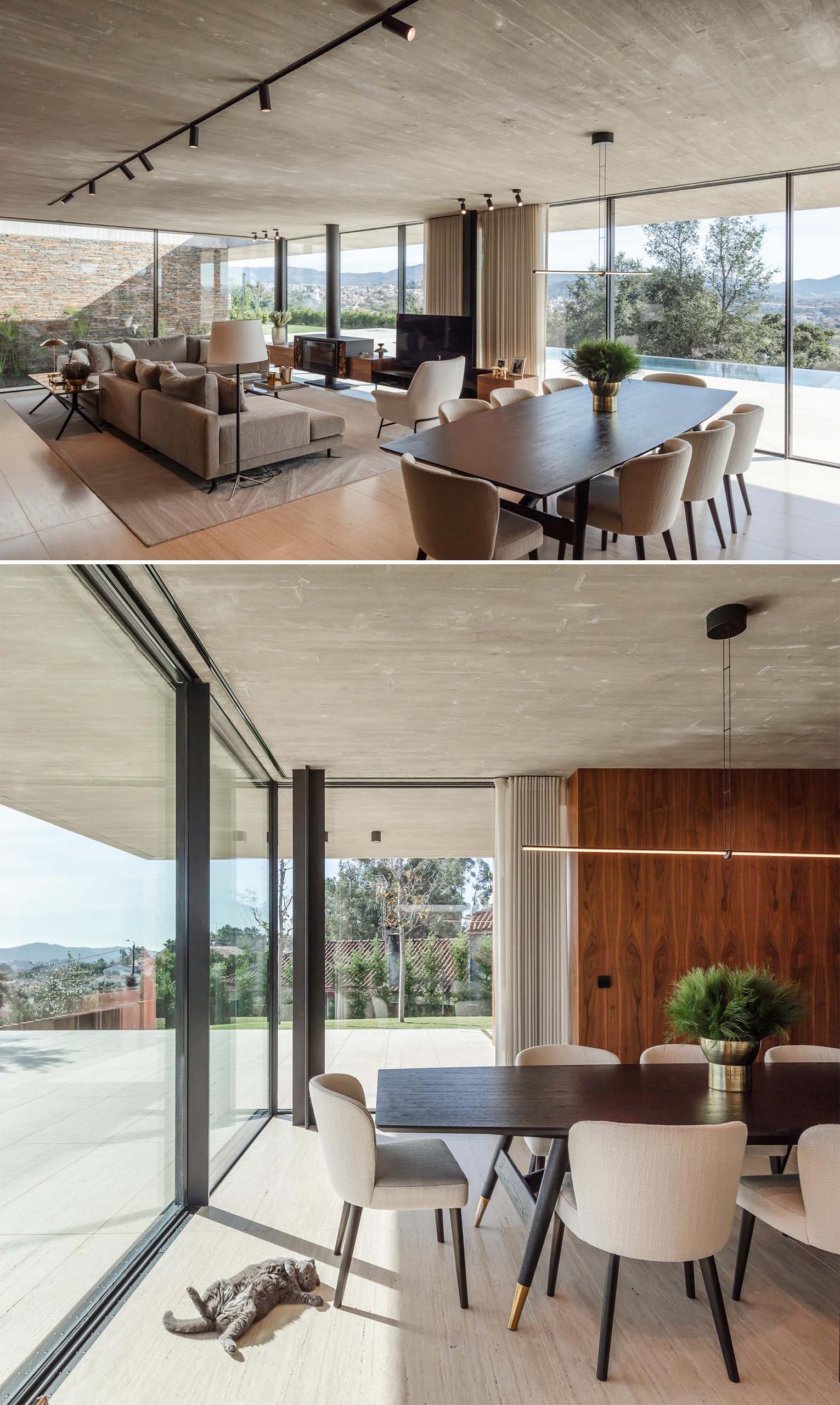 A modern open plan dining area with a wood table, upholstered chairs, and a minimalist linear suspension lamp.