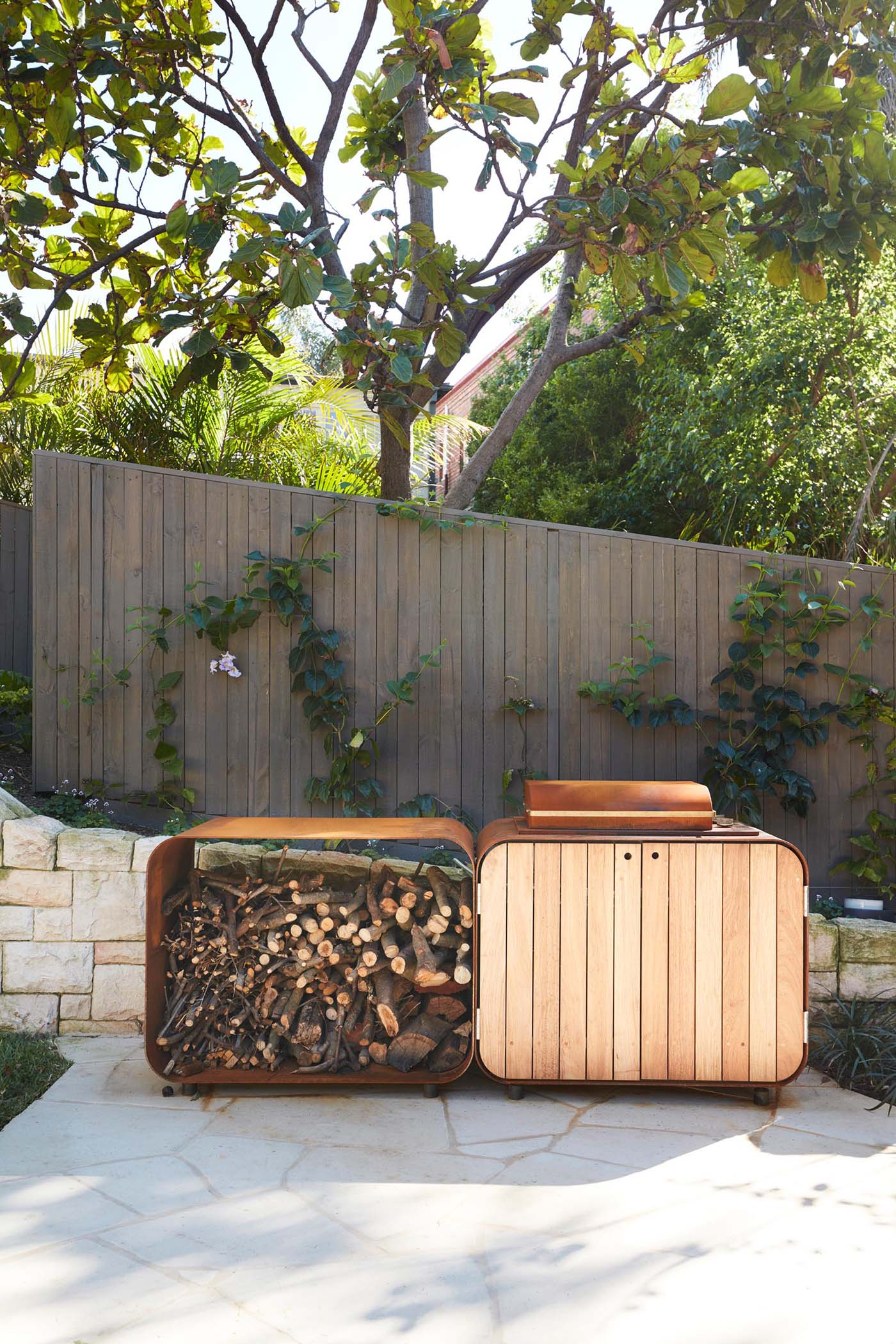 Outdoor firewood storage and bbq area.