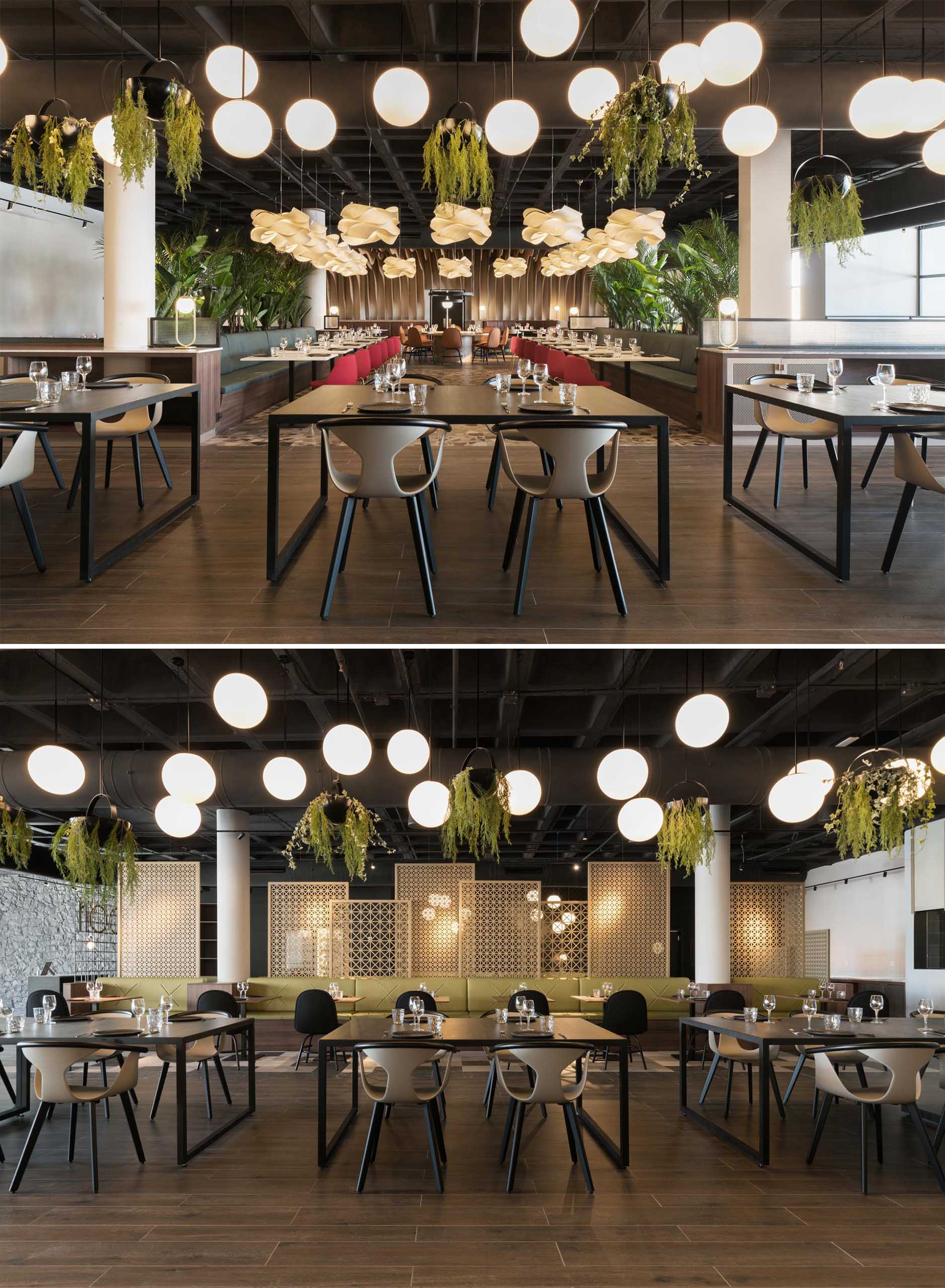 A modern restaurant with greenery, multiple seating areas, and plenty of lighting.