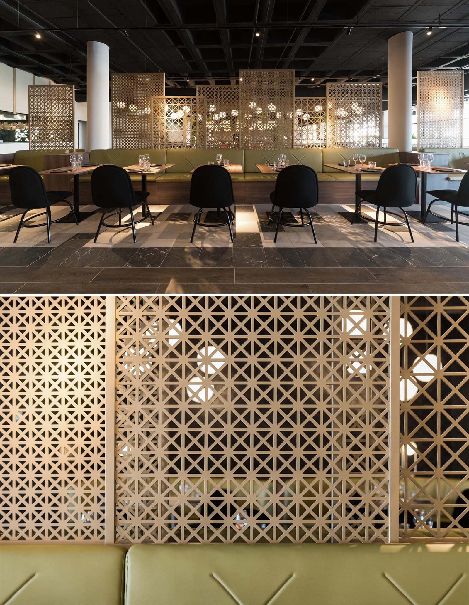 A modern restaurant with greenery, multiple seating areas, patterned wood screens, and plenty of lighting.