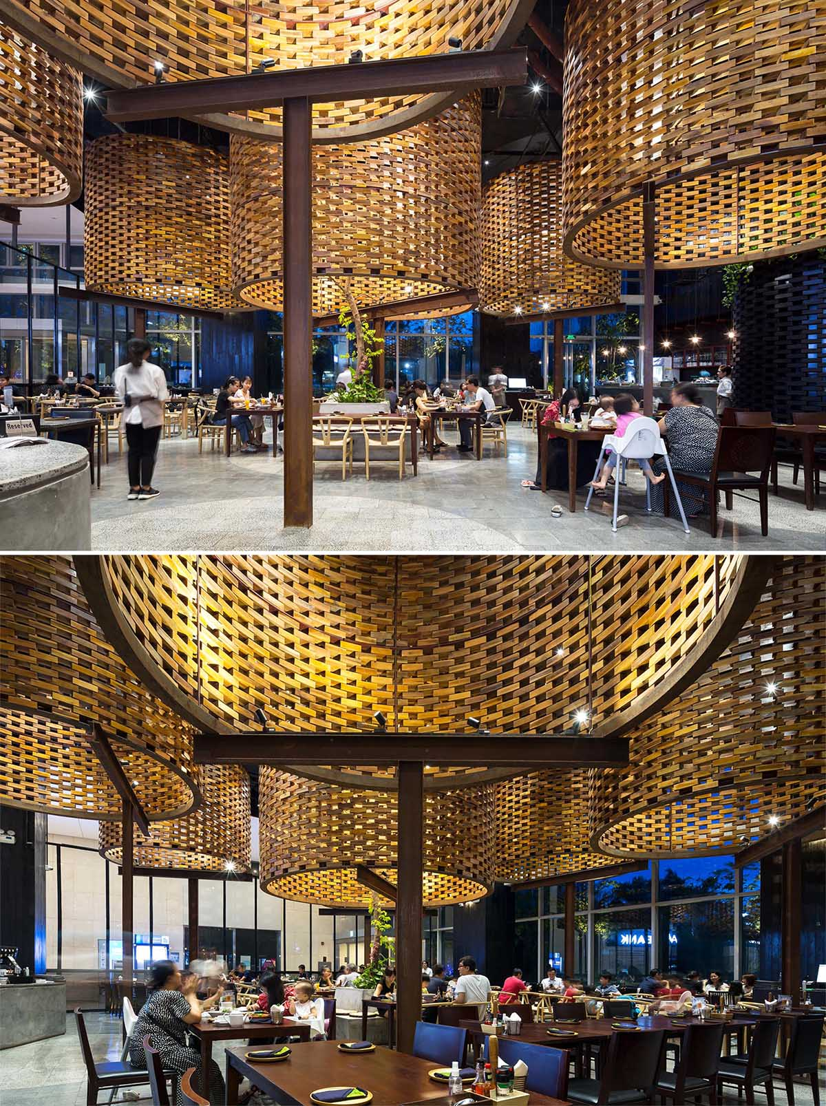 A modern restaurant interior with large sculptural cylinders made from wood bricks.