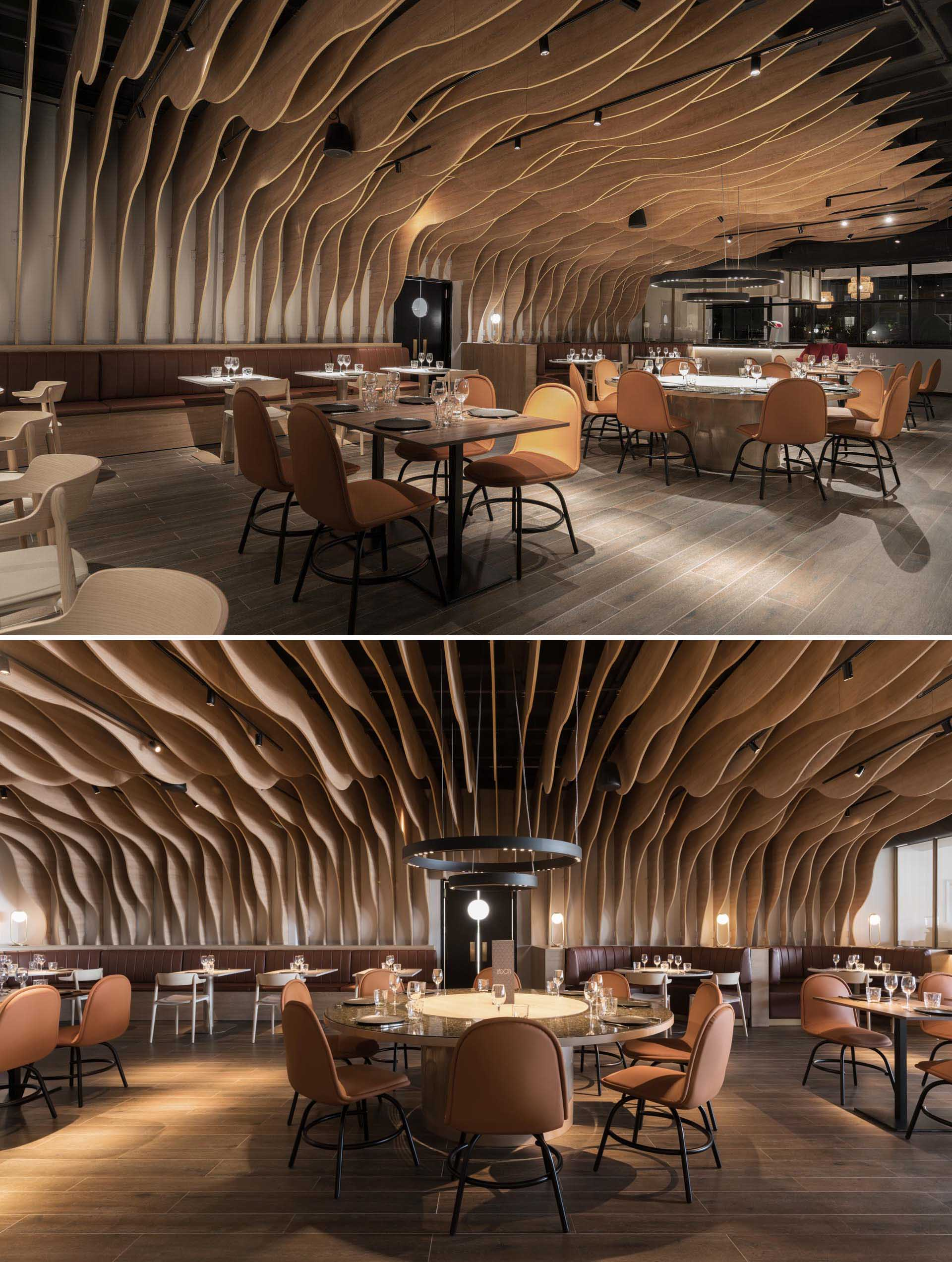 A modern restaurant with sculptural wood fins that cover the walls and ceiling.