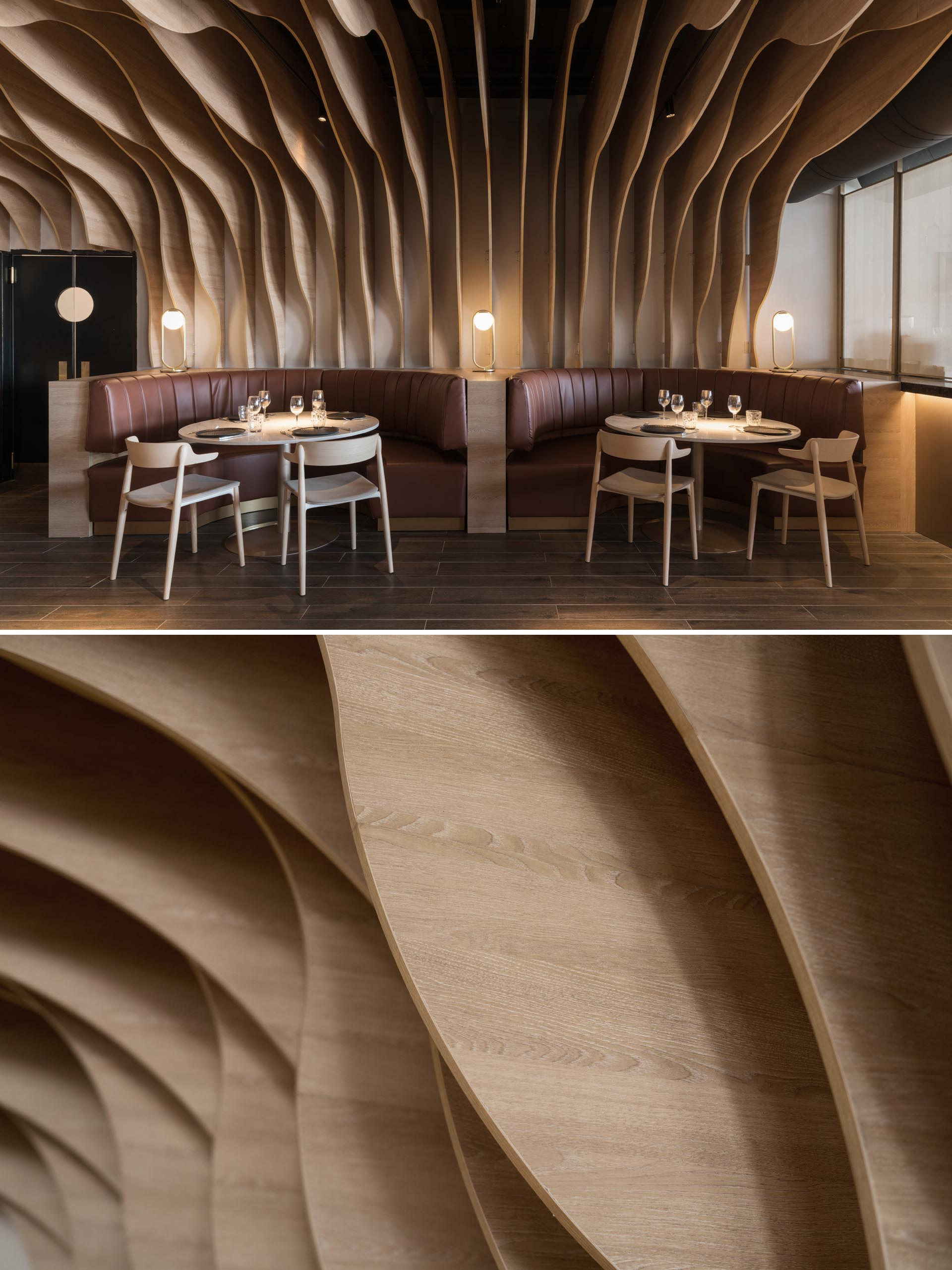 A modern restaurant with sculptural wood fins that cover the walls and ceiling, and match the surrounding furniture and banquettes.
