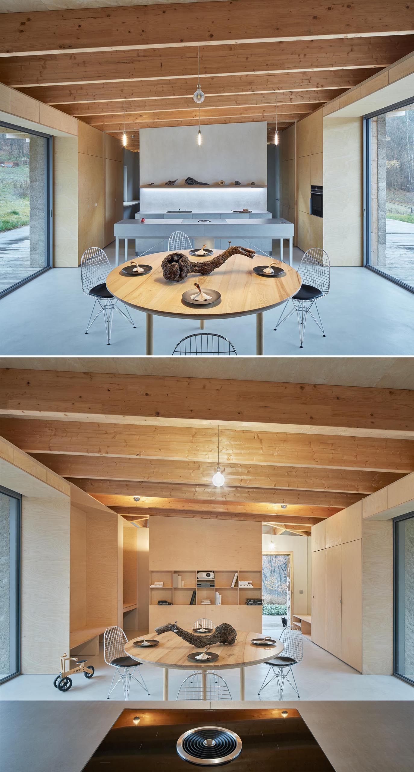 Large glass doors on either side of the social areas of this modern cabin, fill the interior with natural light and open to the deck that surrounds the home.