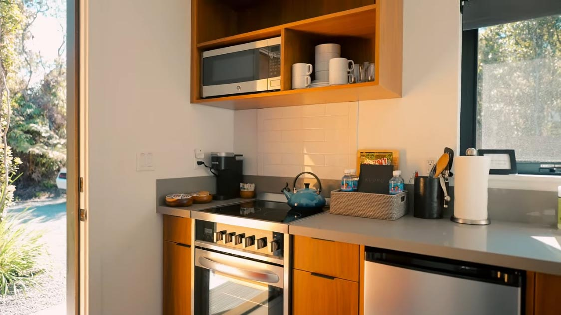 A small kitchenette within a modern tiny home.