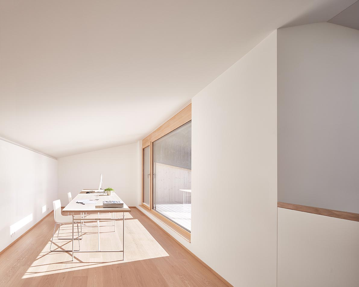 A large window that floods this white room with natural light.