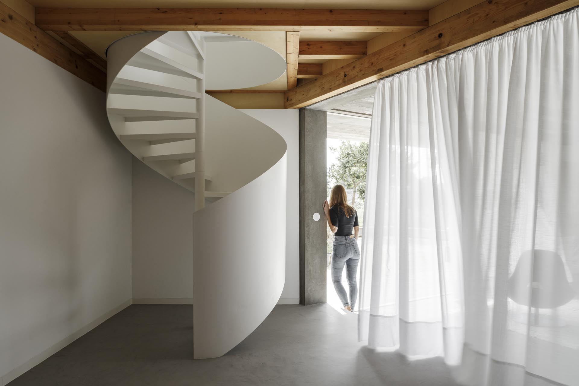 A modern home with a white spiral staircase.
