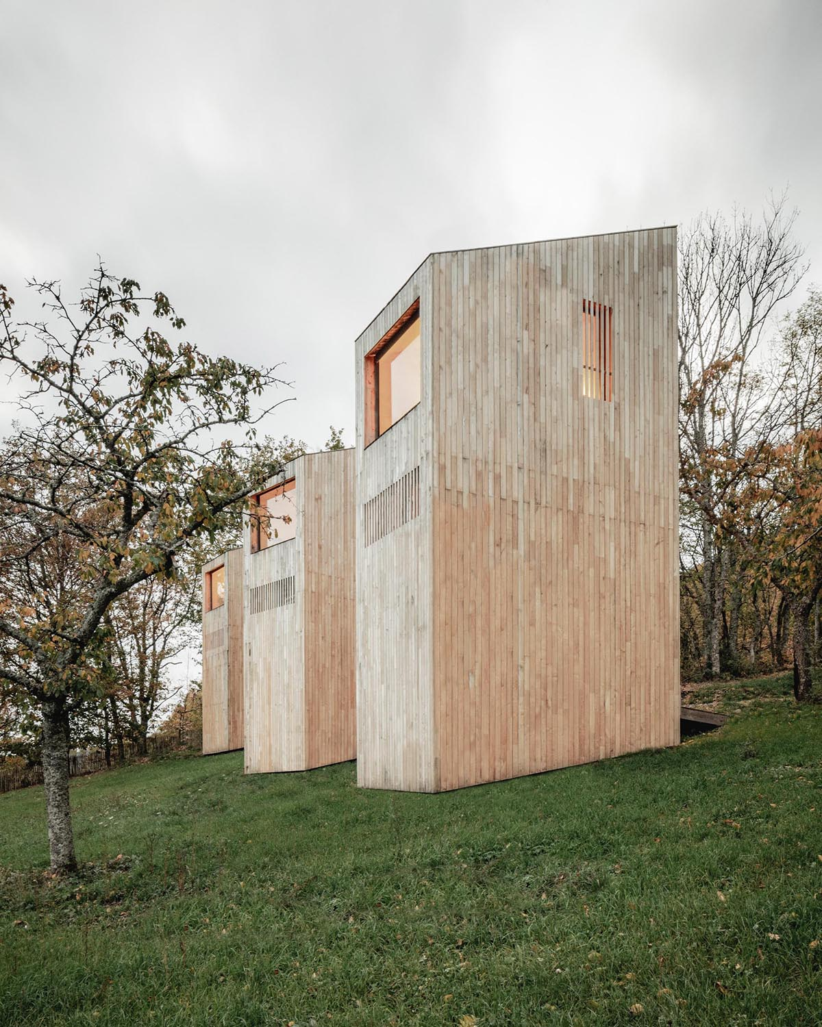 Light wood cabins designed as part of a hotel in France.