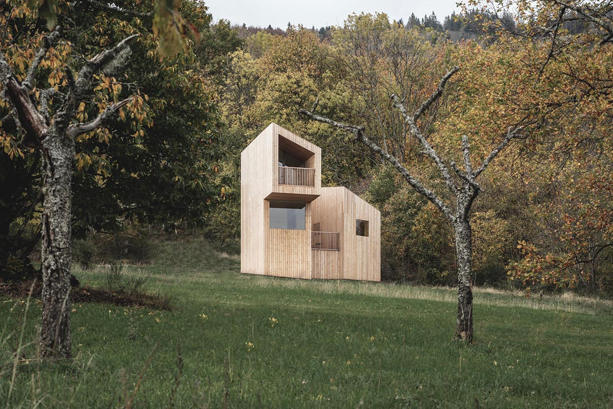 A small wood cabin designed as part of a hotel in France.