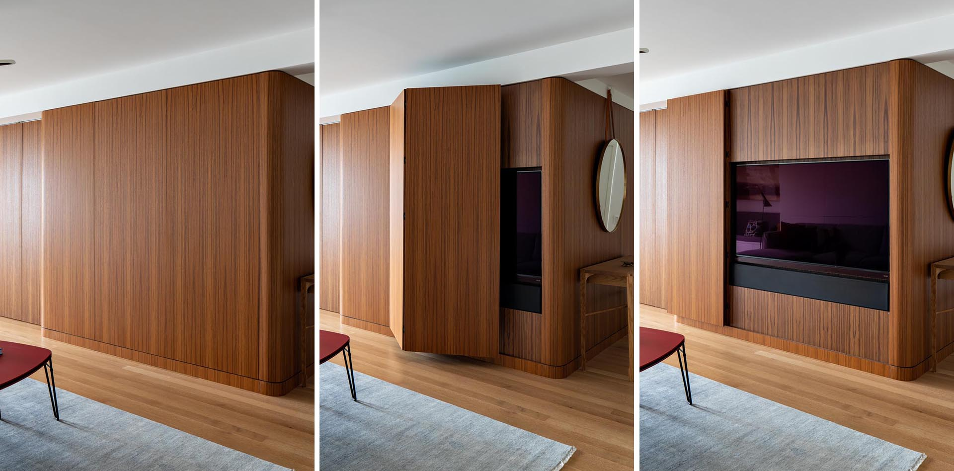 A modern apartment with a wood wall that hides the tv.