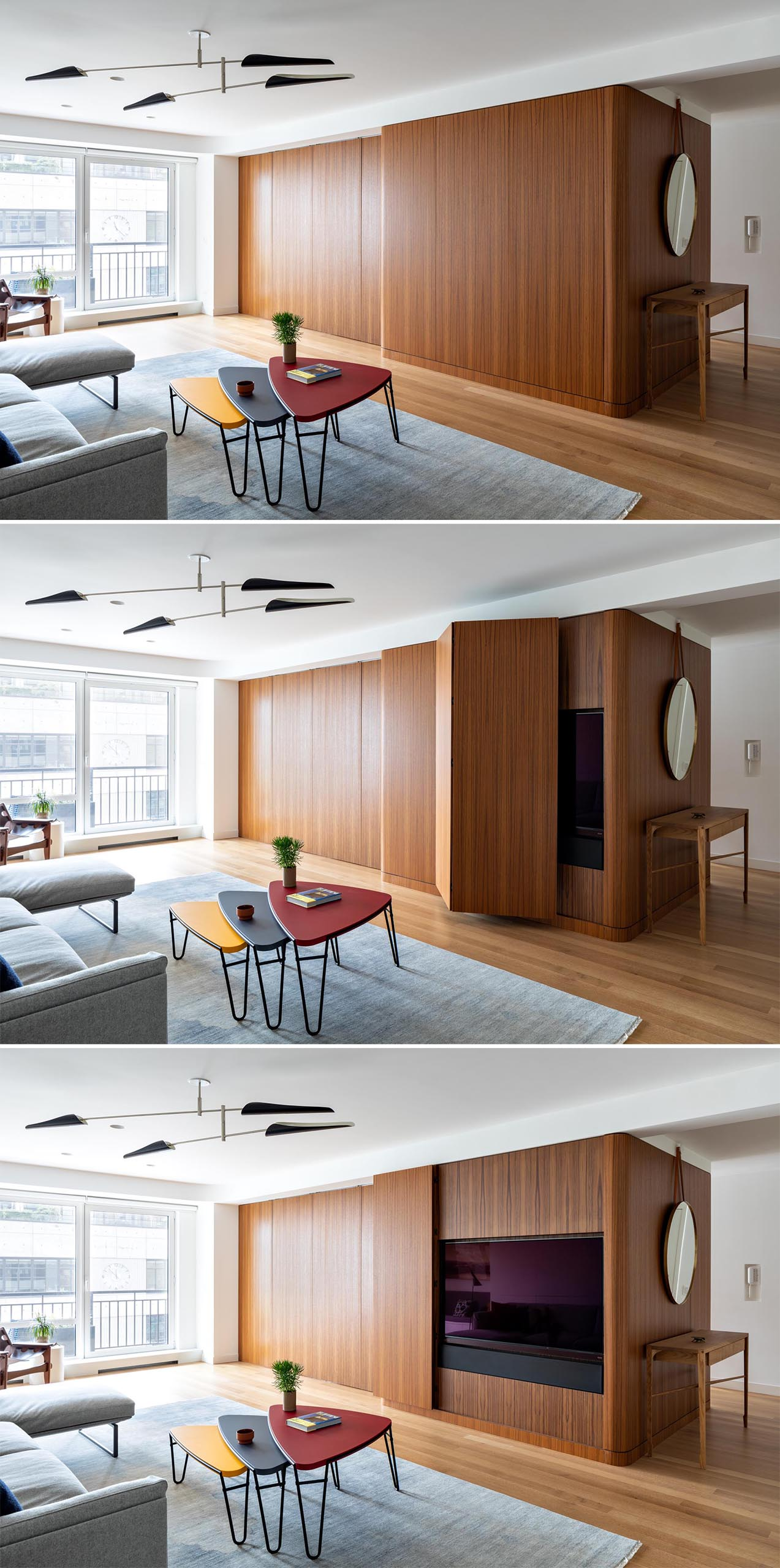 A modern apartment with a teak wall that opens to reveal the hidden TV.