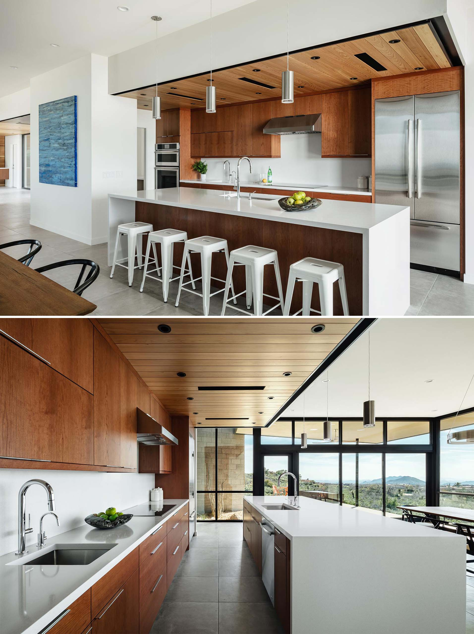 This modern kitchen features a floating cedar ceiling that aligns with the entry ceiling beyond. There's also cherry veneer cabinets and quartz countertops.
