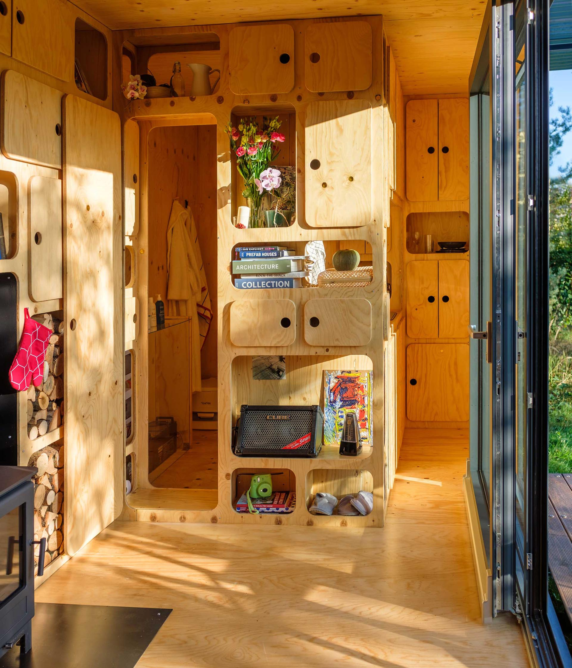 A tiny home with plenty of plywood cabinetry.