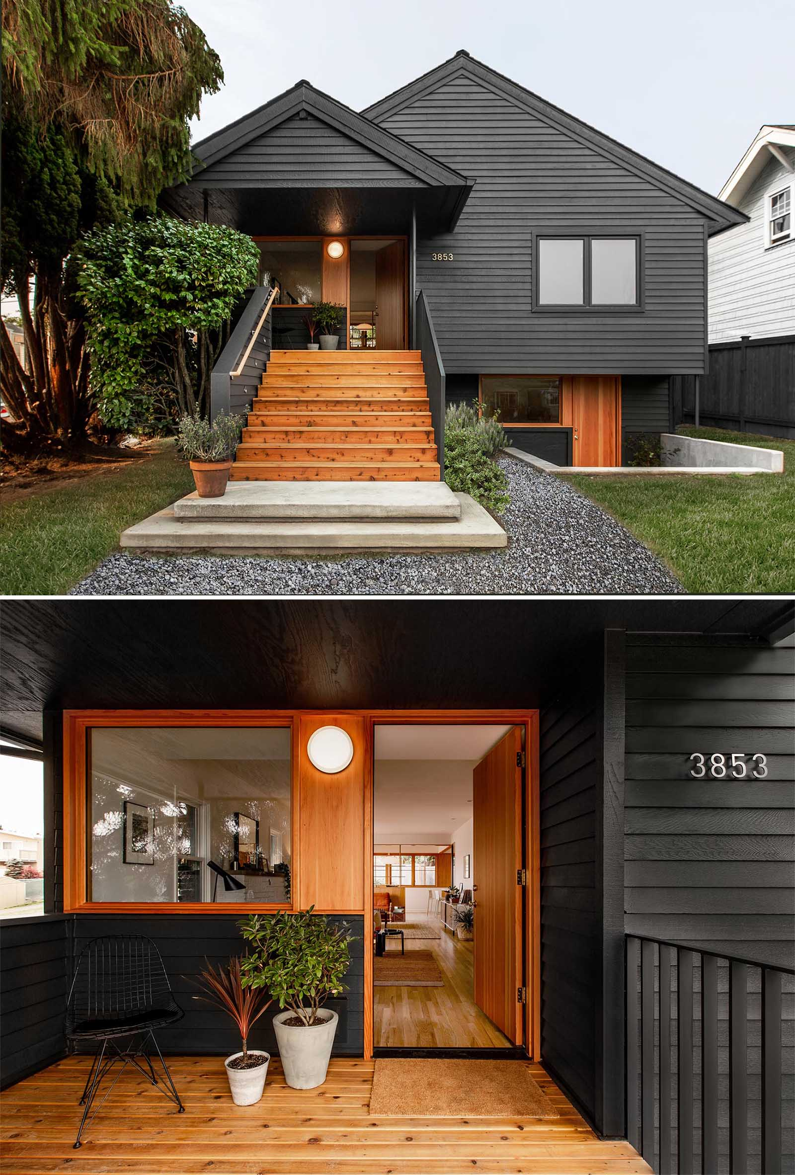 A remodeled 1920s bungalow received an updated black exterior, wider wood stairs that lead up to the front porch, as well as a secondary lower entrance that can be used to access a home office, guest quarters, or secondary living unit.