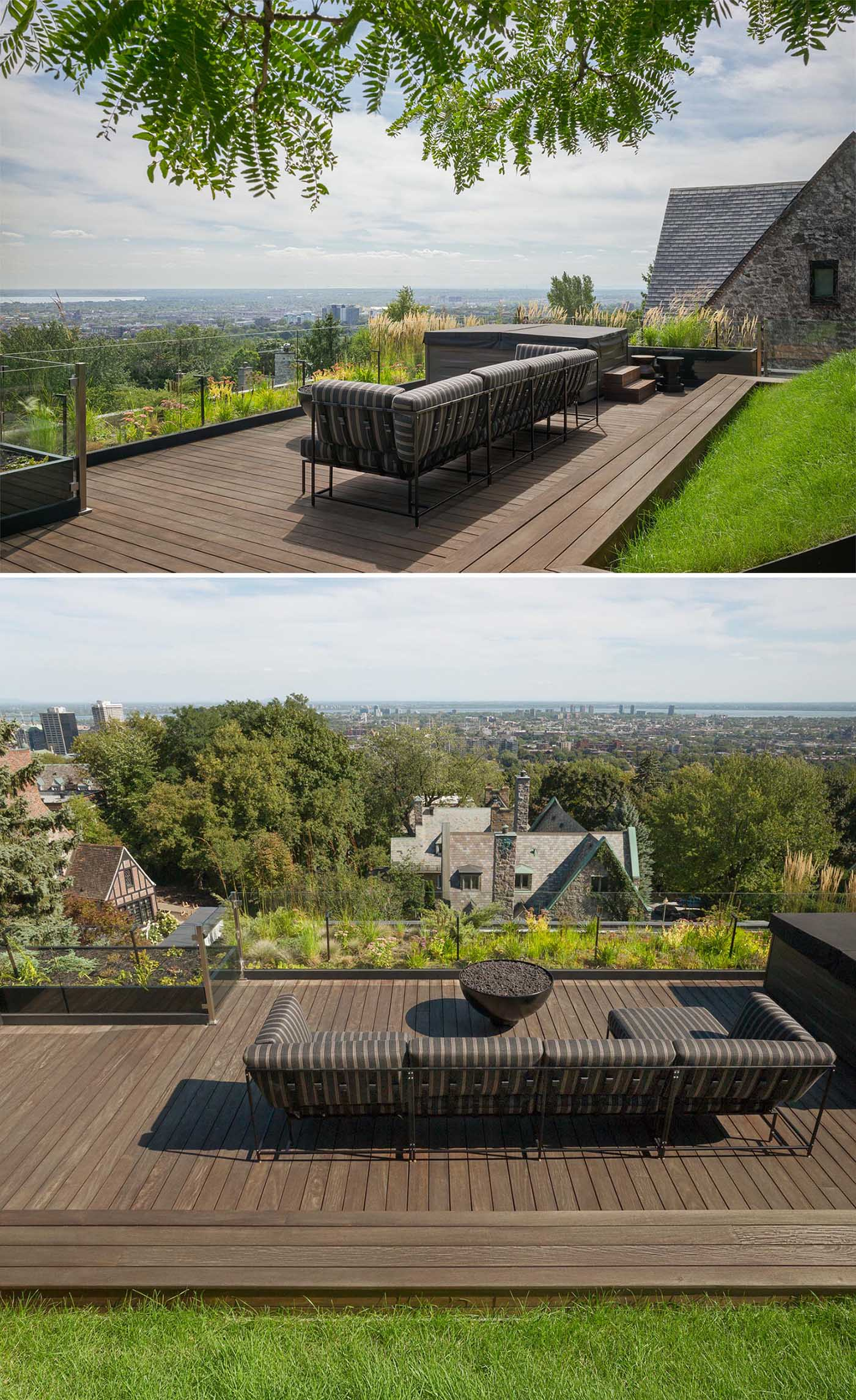 A modern rooftop terrace with an Ipe wood deck, exterior lighting, a sofa, and wildflowers.