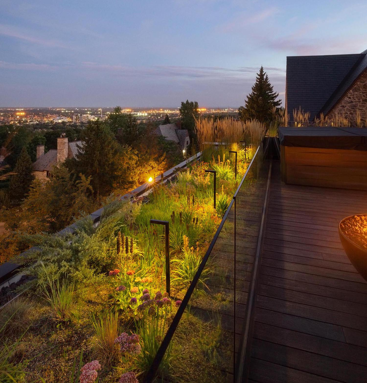 A modern rooftop terrace with outdoor lighting.