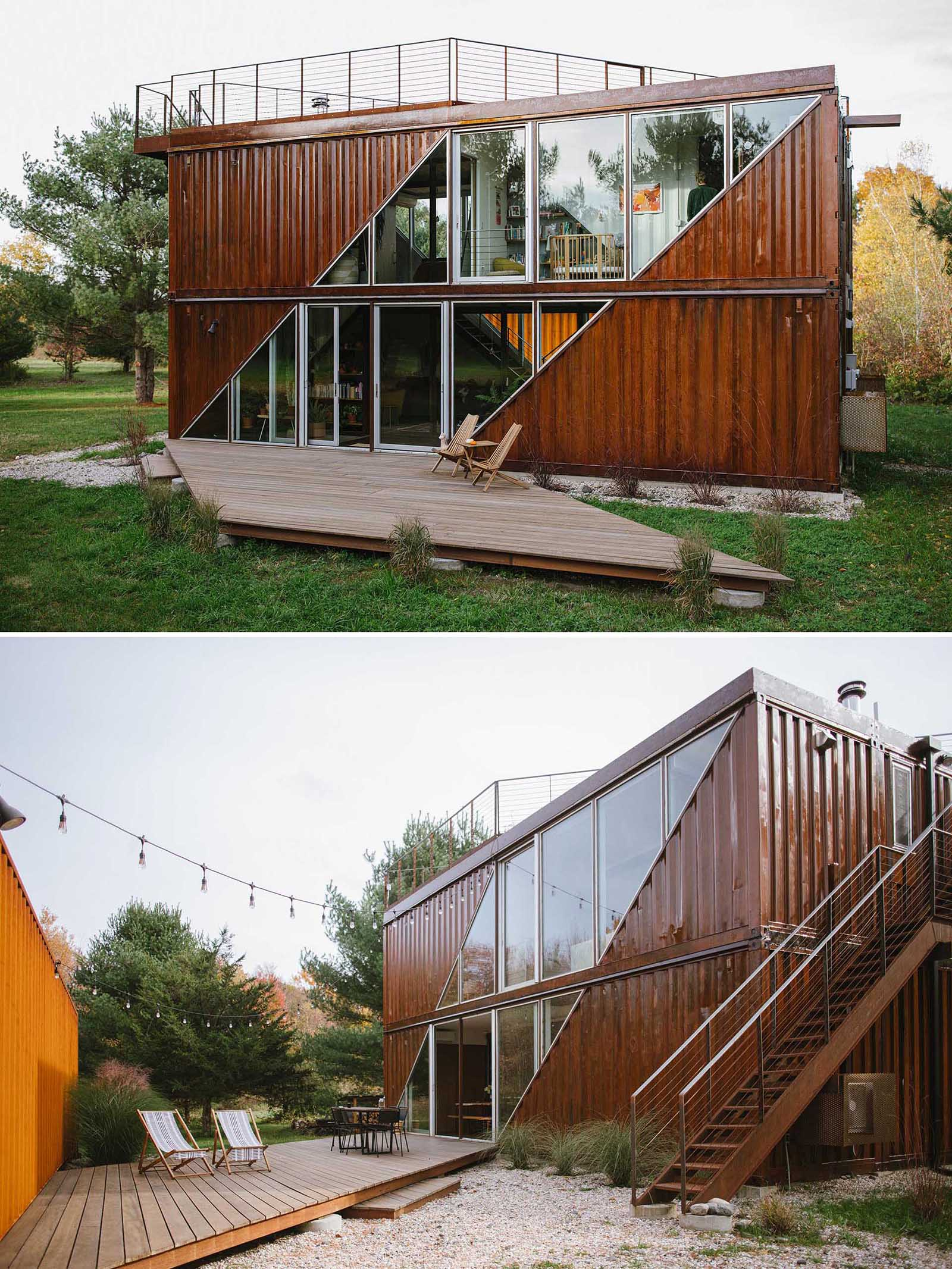 A modern shipping container home with two levels and outdoor decks.