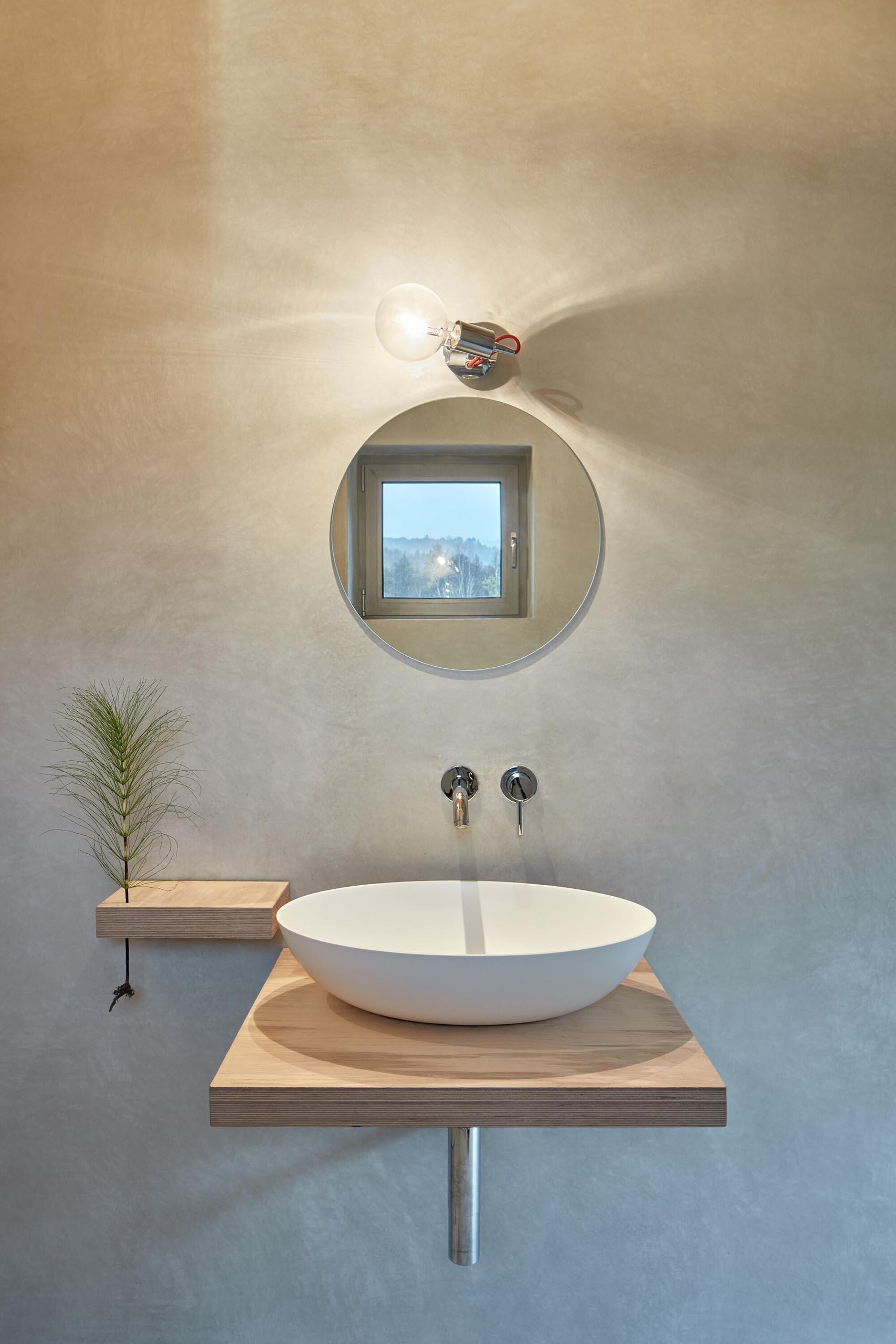 A minimalist wood bathroom vanity.