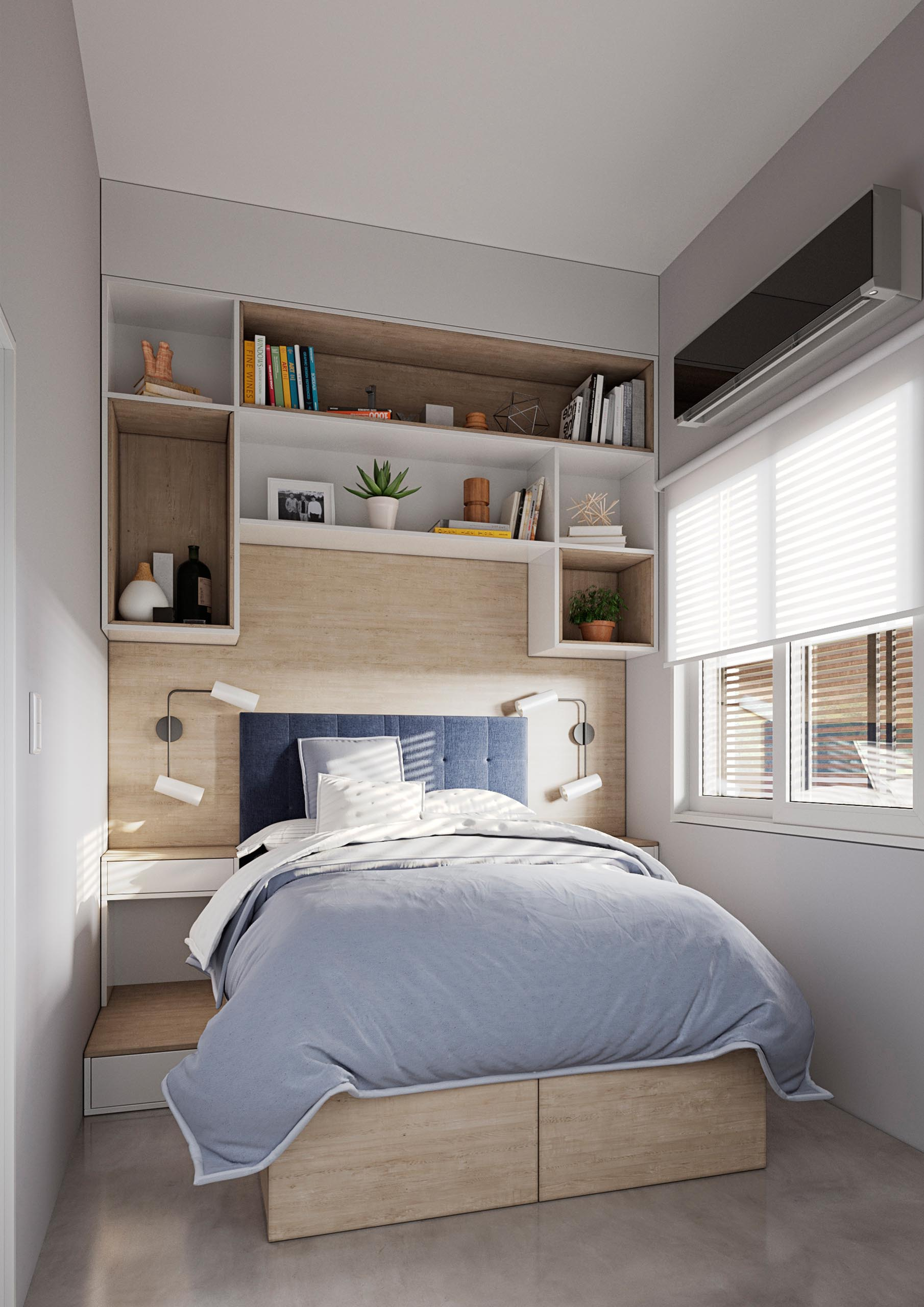 A tiny home bedroom with wood accents, white cabinetry, and storage under the bed.