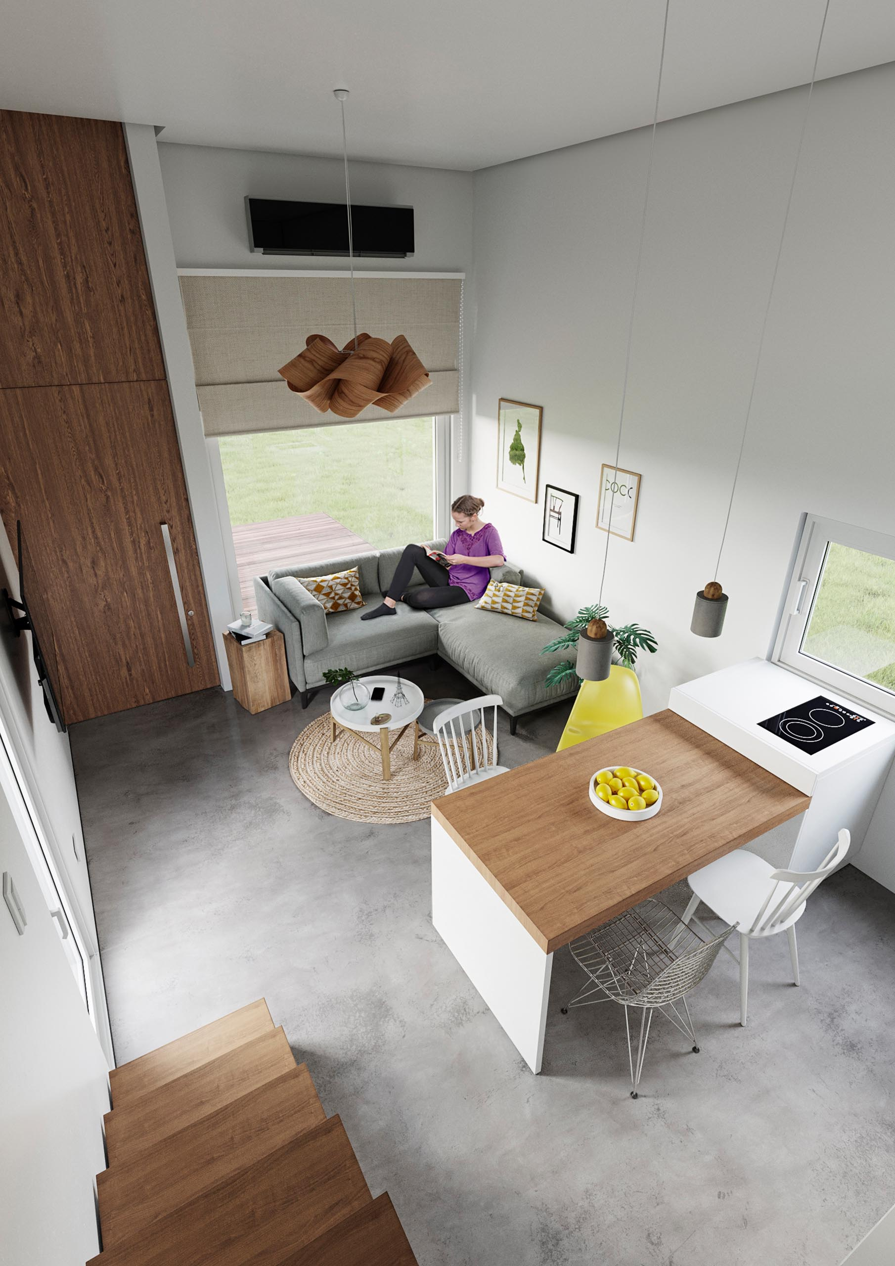A modern precast concrete relocatable tiny home with an open plan living room, dining area, and kitchen.