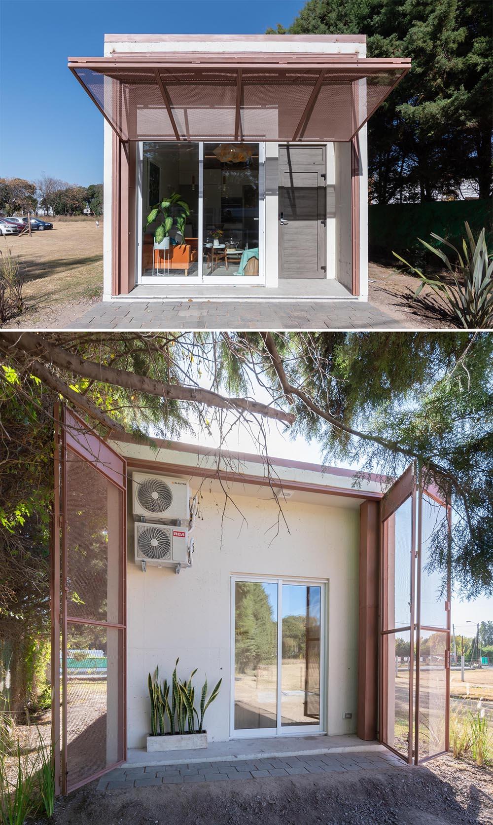 A modern precast concrete relocatable tiny home with a folding exterior screens.