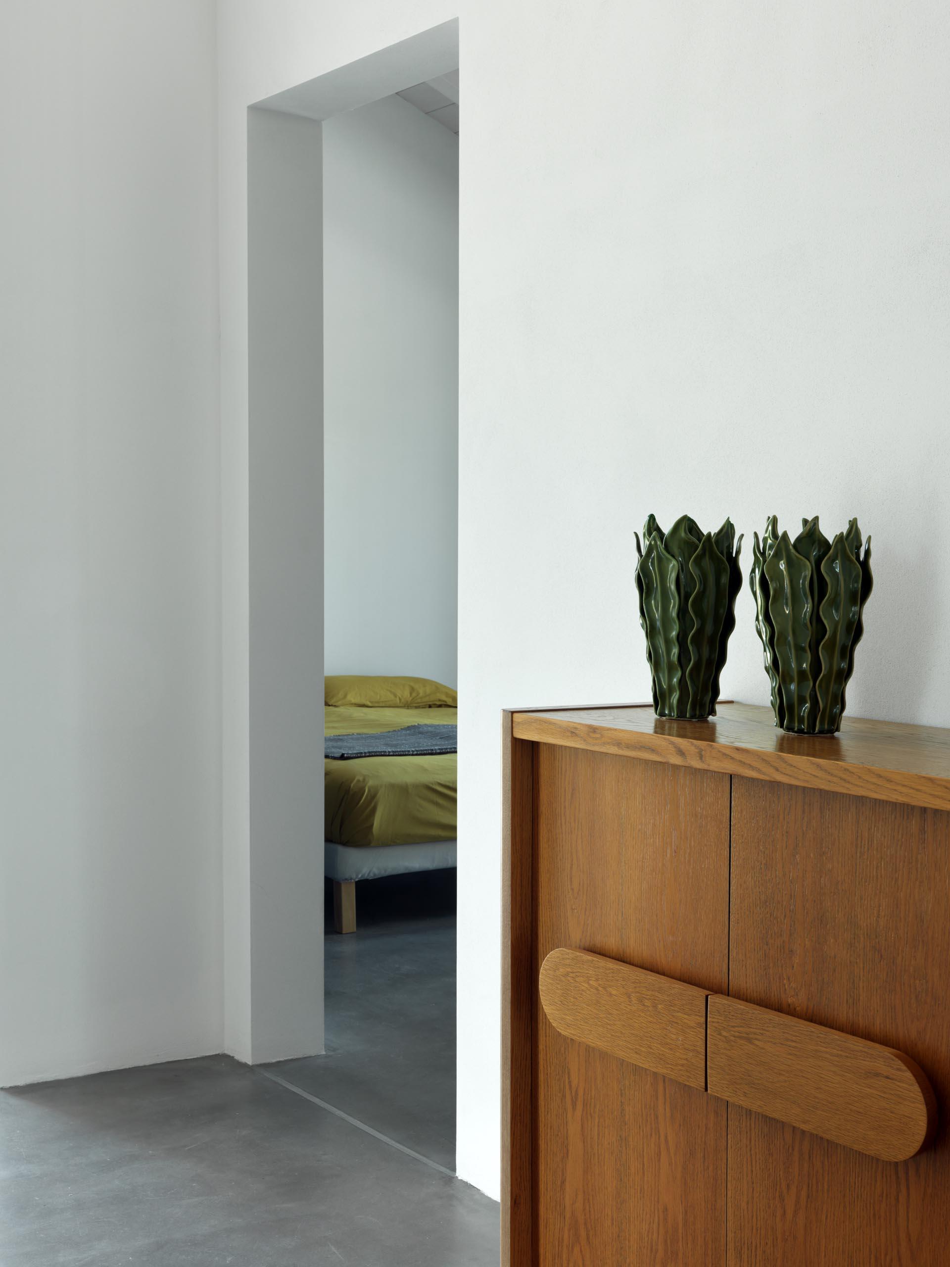 A modern farmhouse that's minimally furnished.