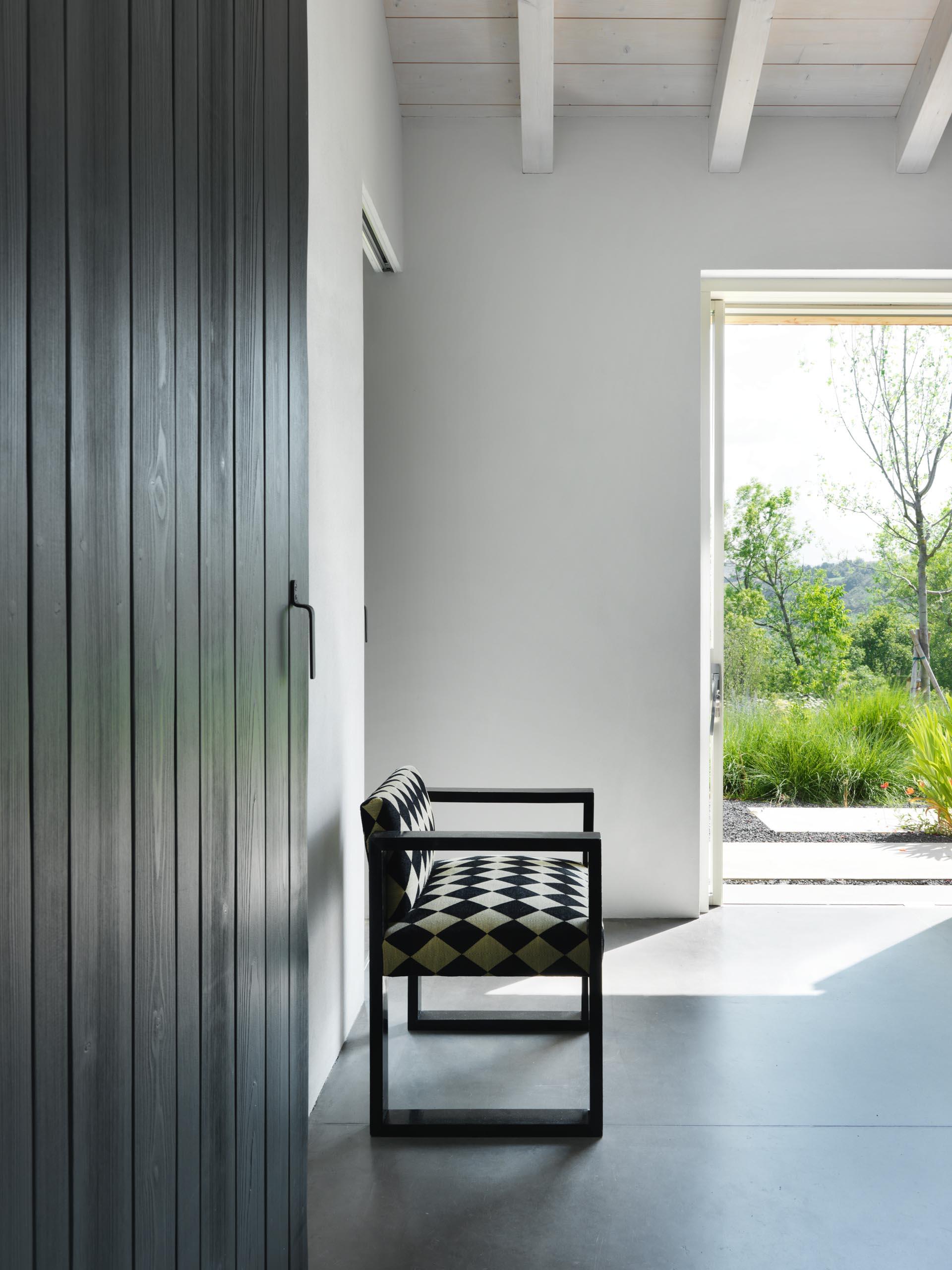 A modern black wood bedroom door.