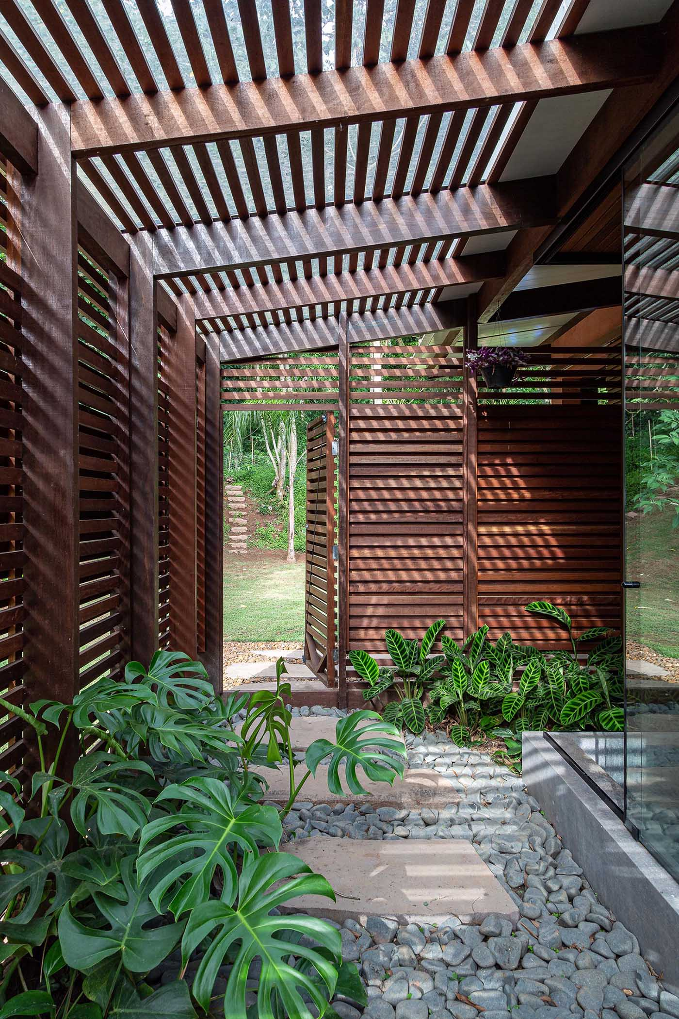 A wood slat screen allows for privacy and lets natural air and light flow through.