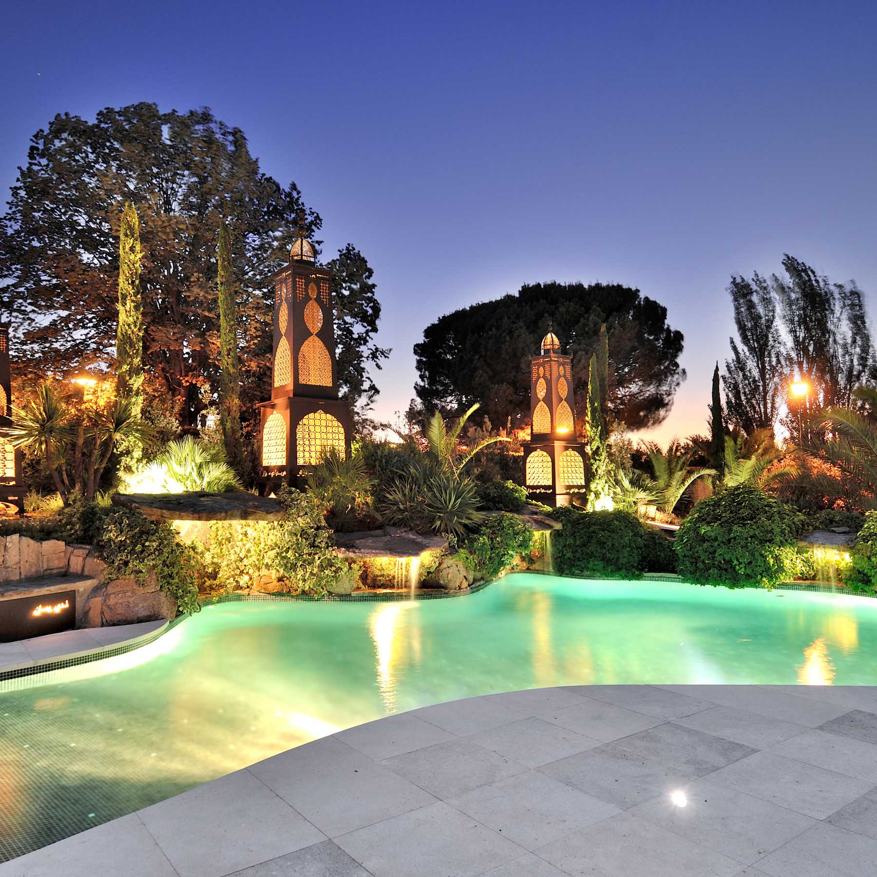 Private garden with swimming pool and lanterns.
