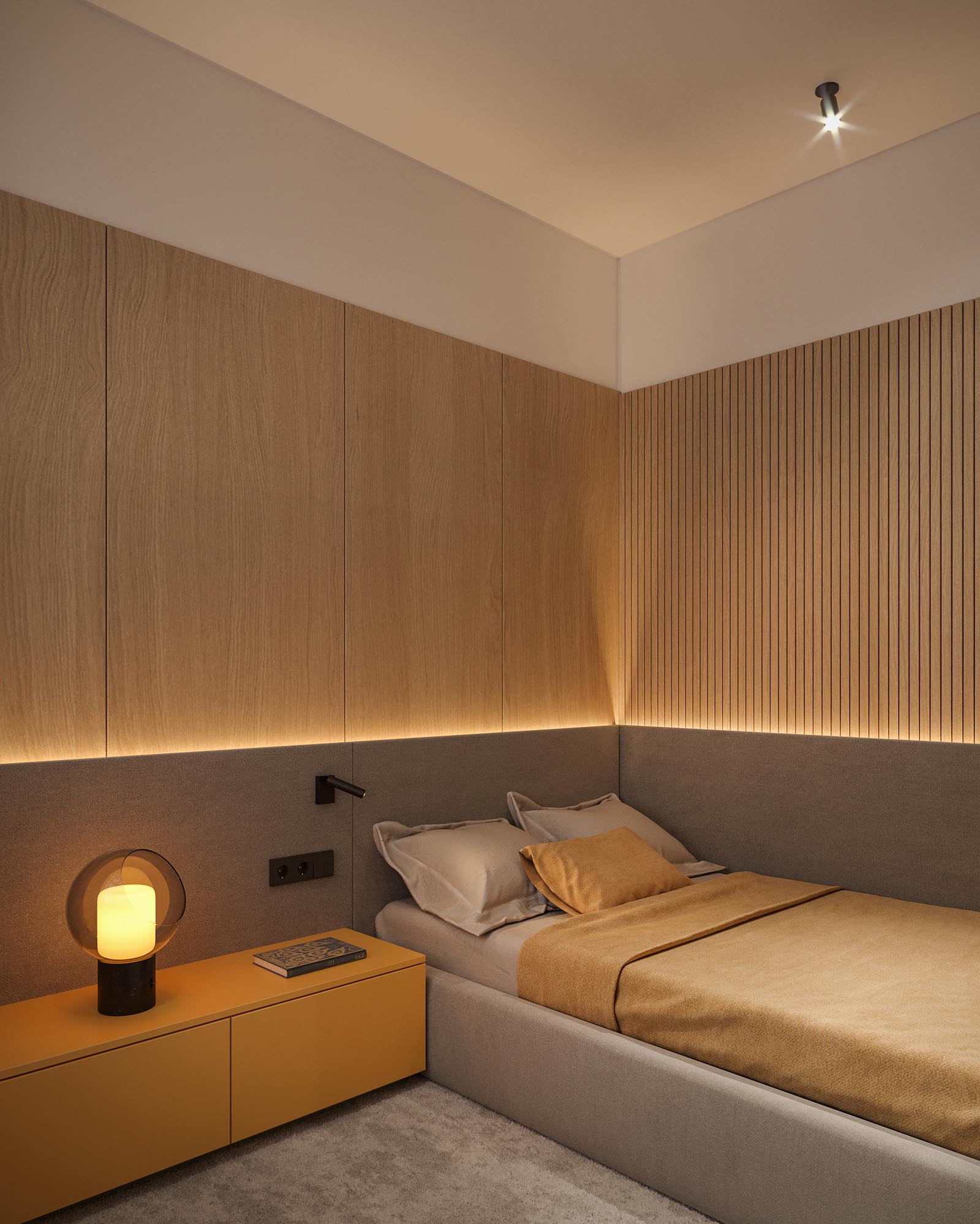 A modern bedroom with a backlit headboard and partial wood accent wall.