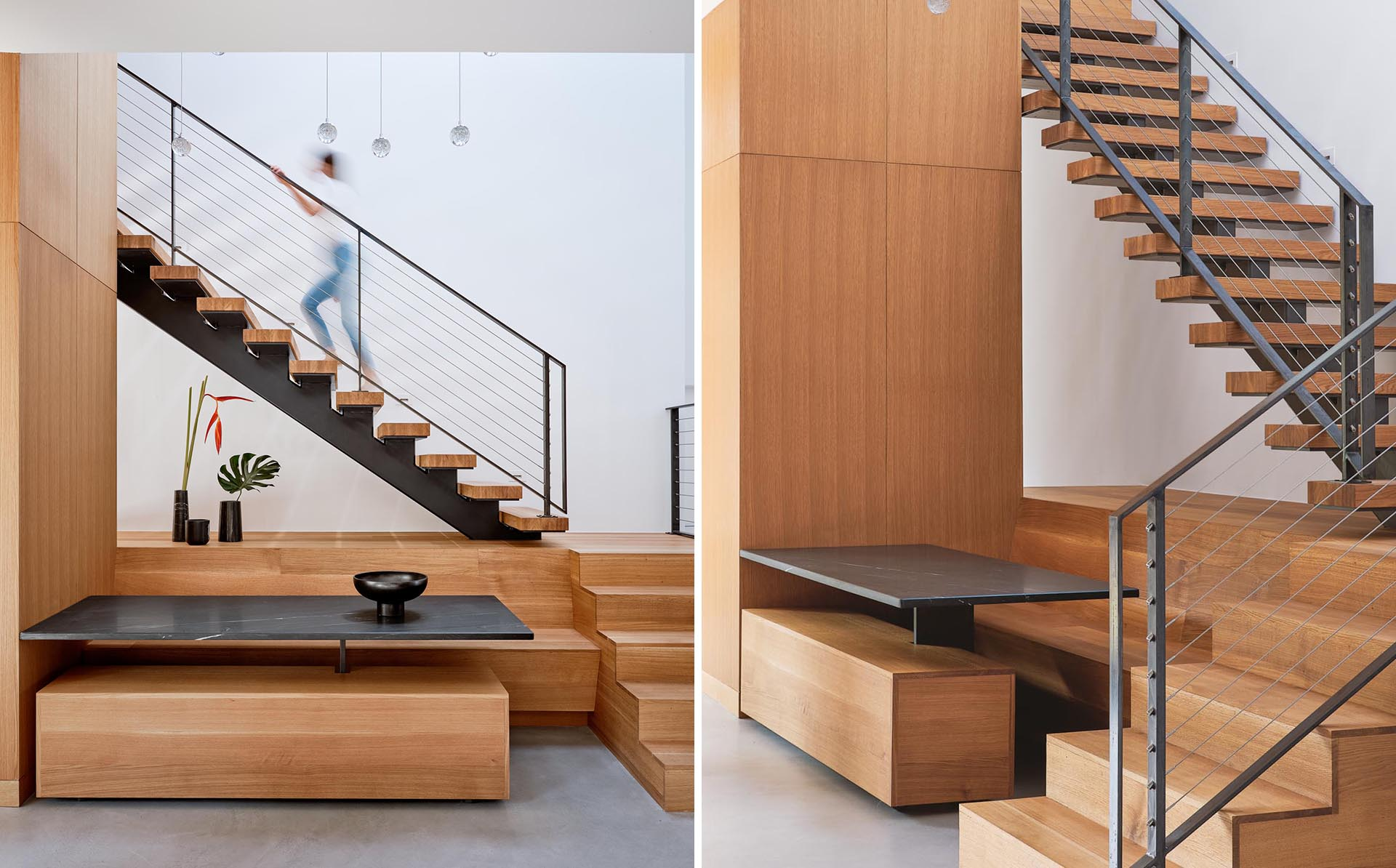 A modern house addition that includes a dining area built into the space underneath the stairs.