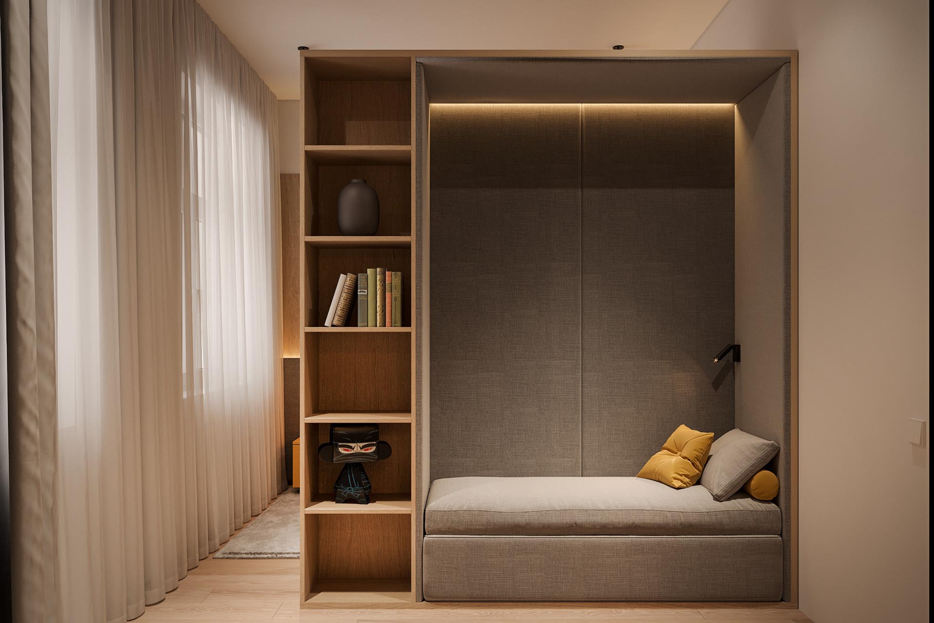 A built-in reading nook is lined with gray upholstered walls, making it a cozy and private space.