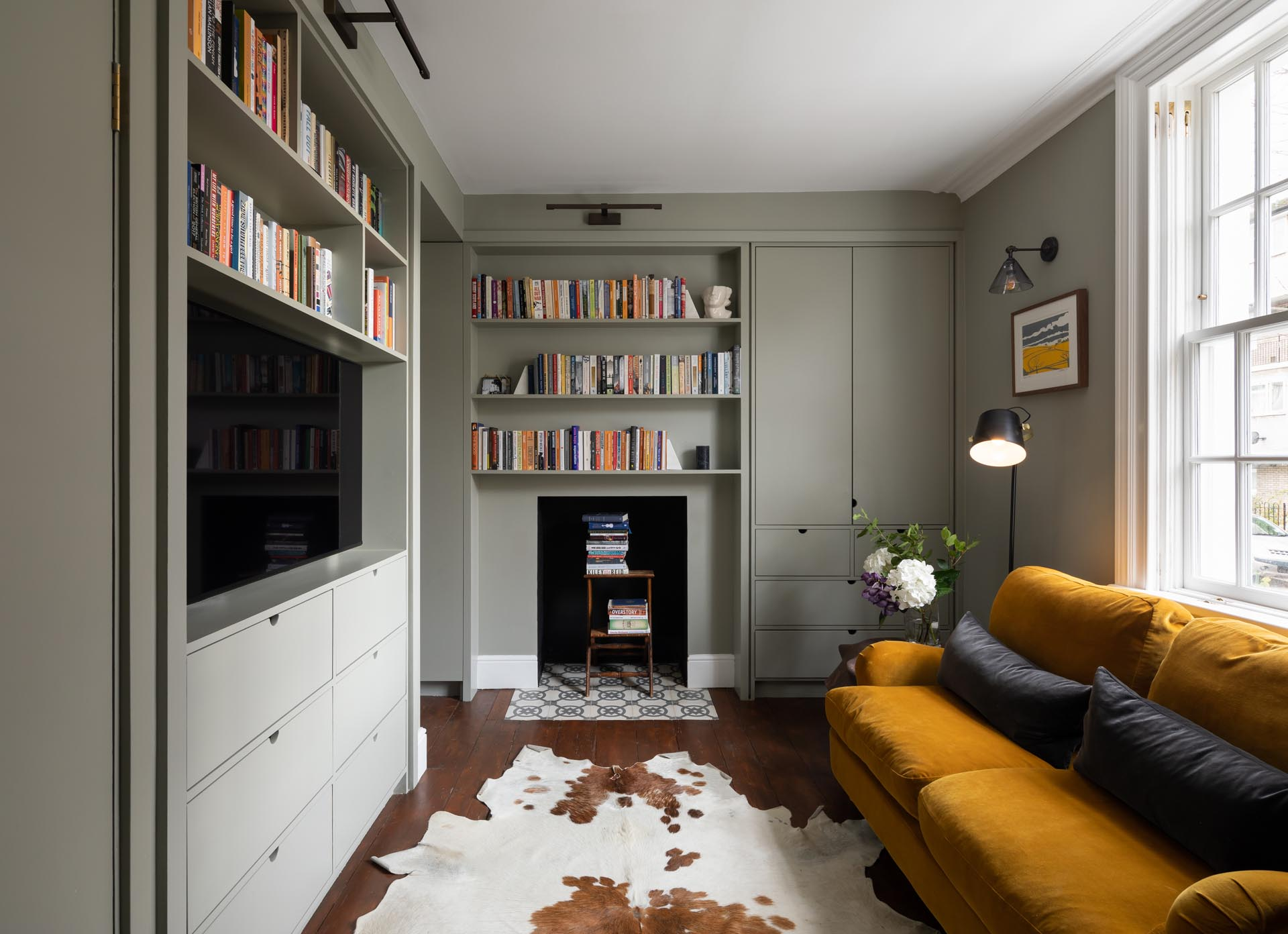 A remodeled living room with gray and white shelving.