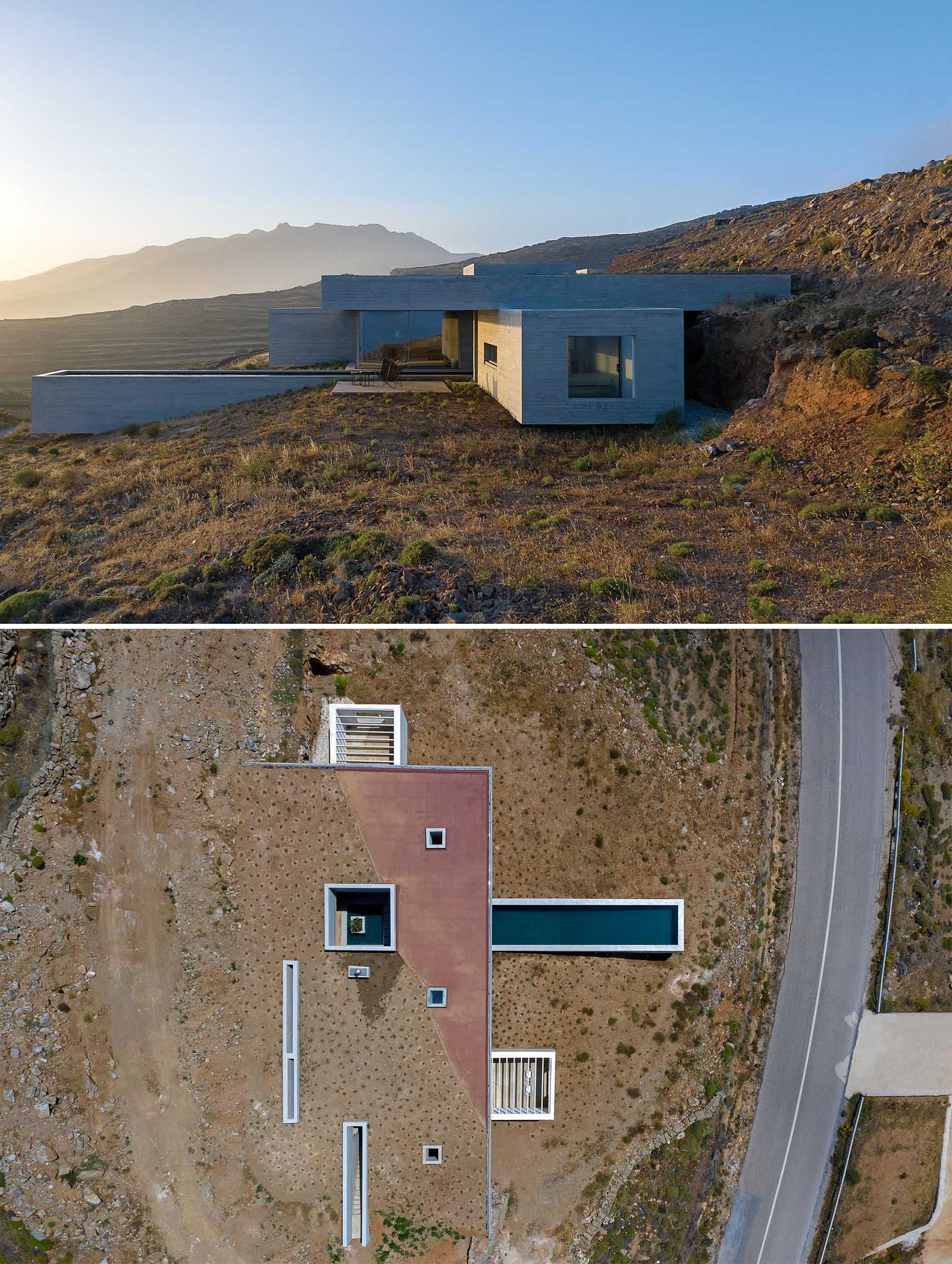 Emerging from the natural landscape as a man-made cave, this modern concrete home has been designed to somewhat blend in with its surroundings, with the partial green roof acting as a continuation of the hillside.