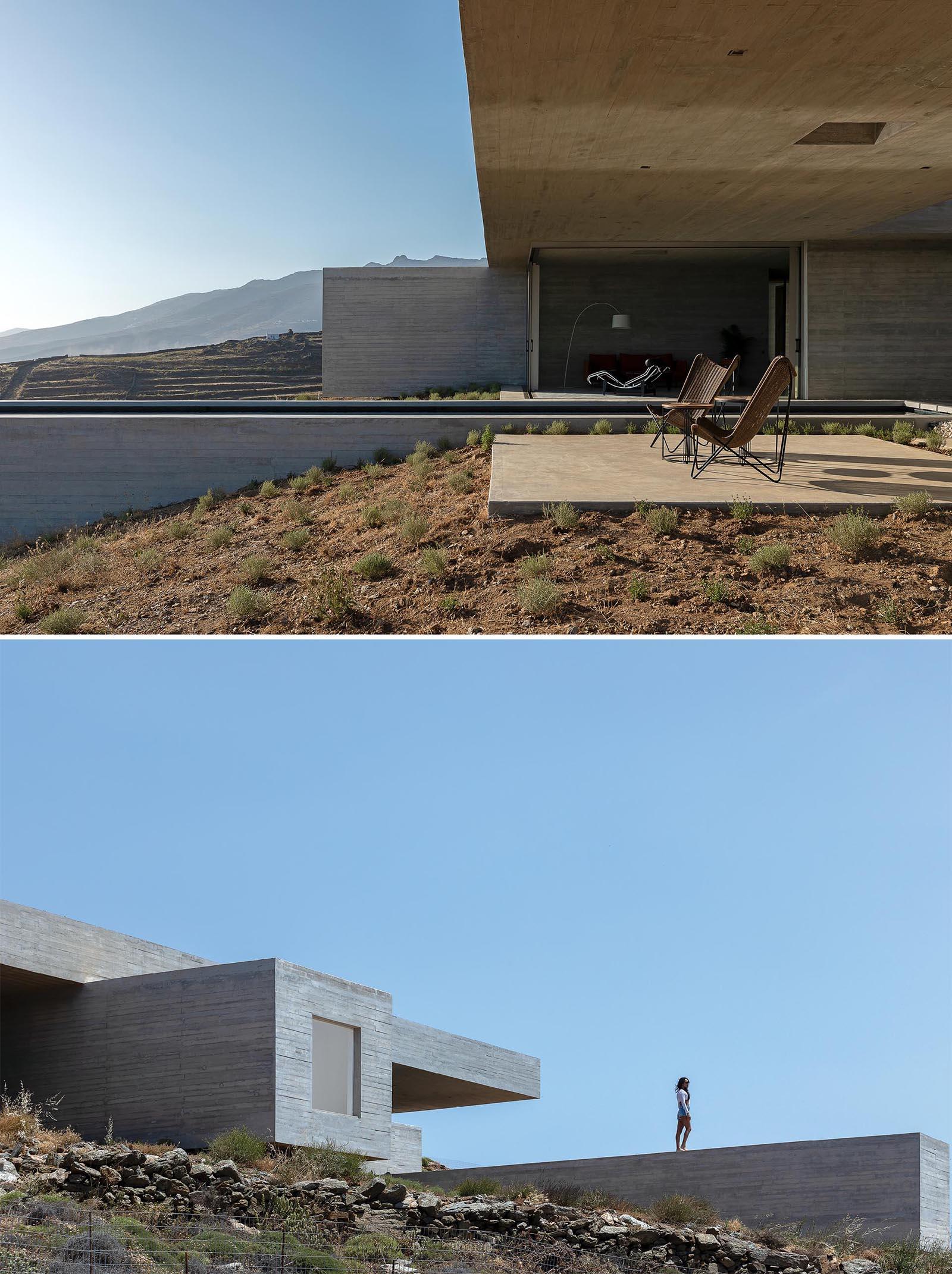 A modern concrete house built into a hillside.