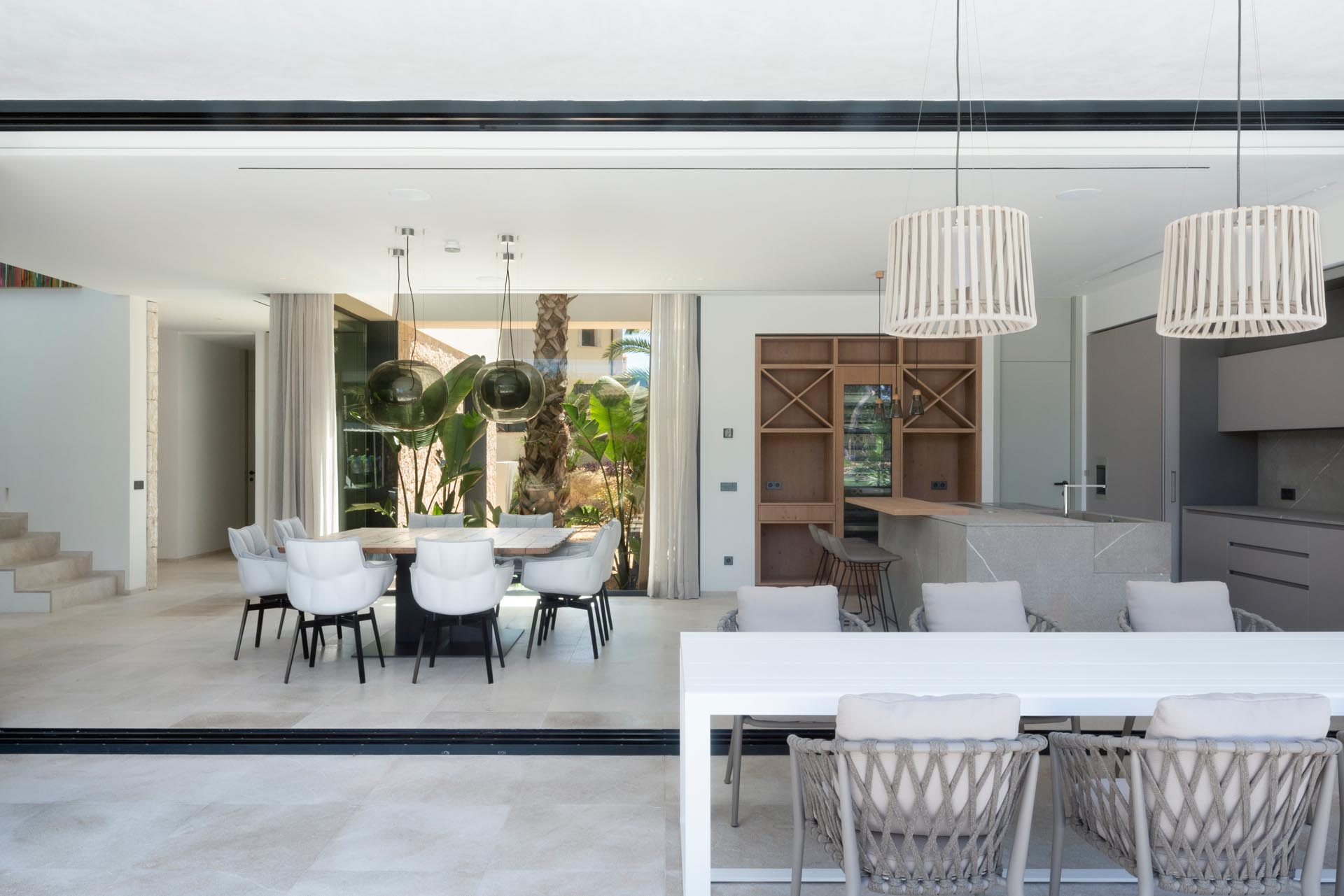 This modern home has large sliding glass walls that connect with the outdoors, creating a single giant entertaining space that's perfect for indoor / outdoor living.