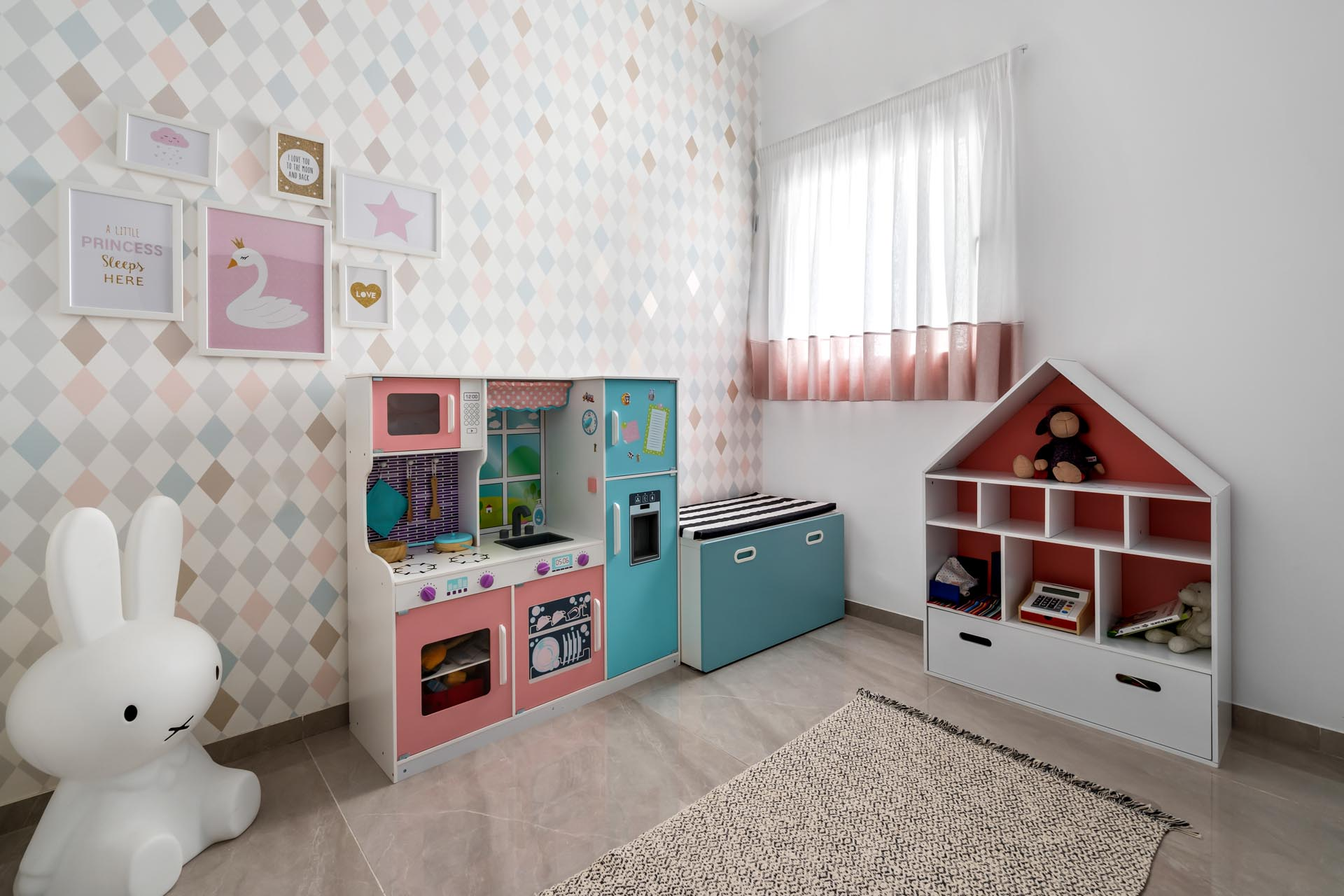 A modern playroom incorporates different shades of pink.