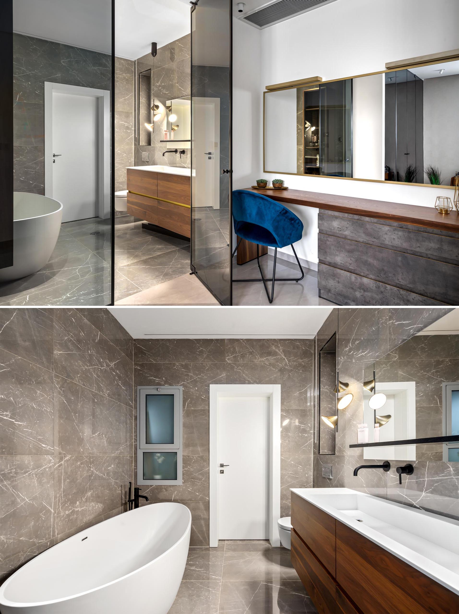 A bedroom with a make-up vanity area and an en-suite bathroom with a freestanding bathtub.