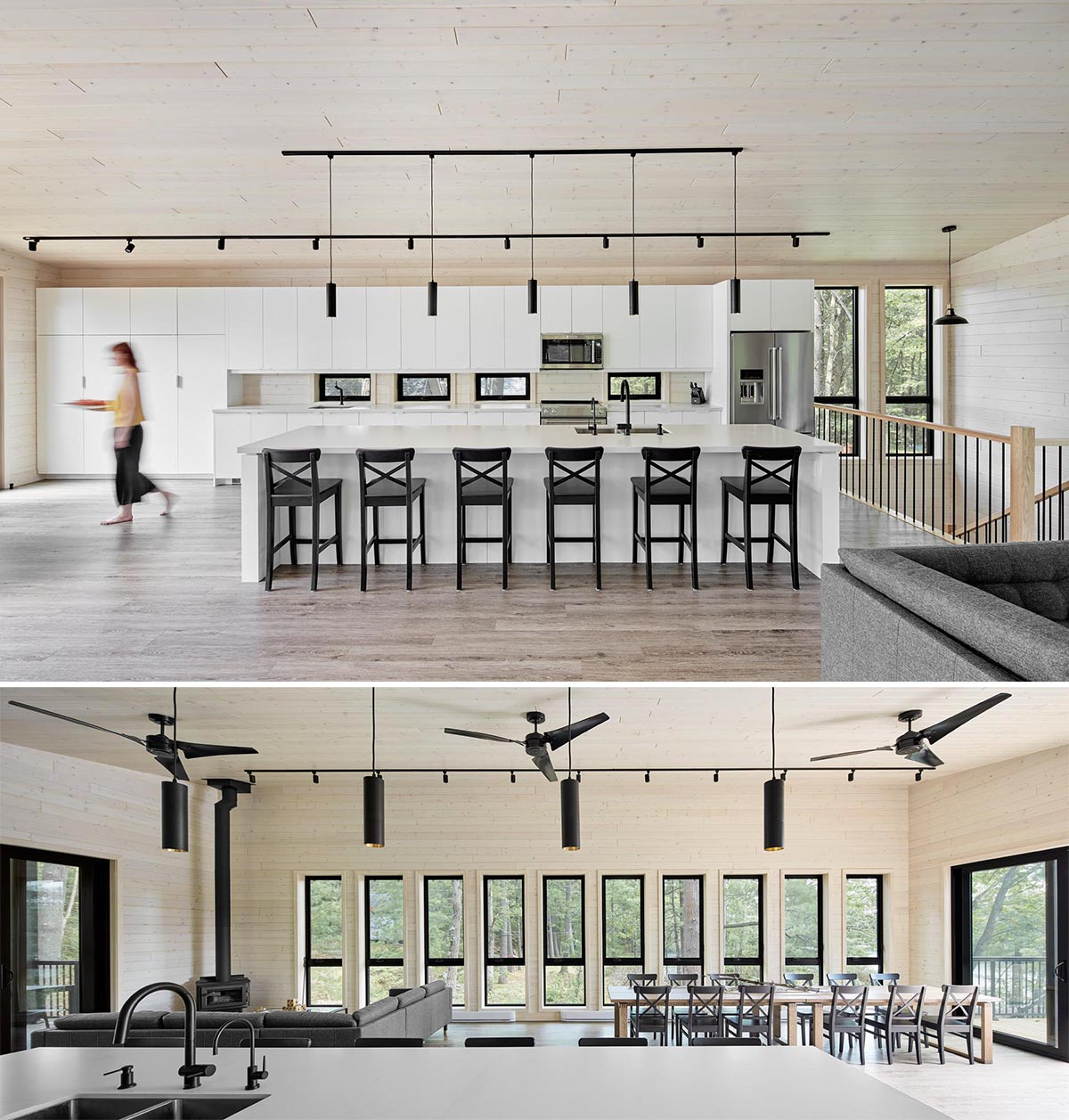This modern kitchen includes all-white cabinets that are contrasted by the black lighting and black stools at the large island.