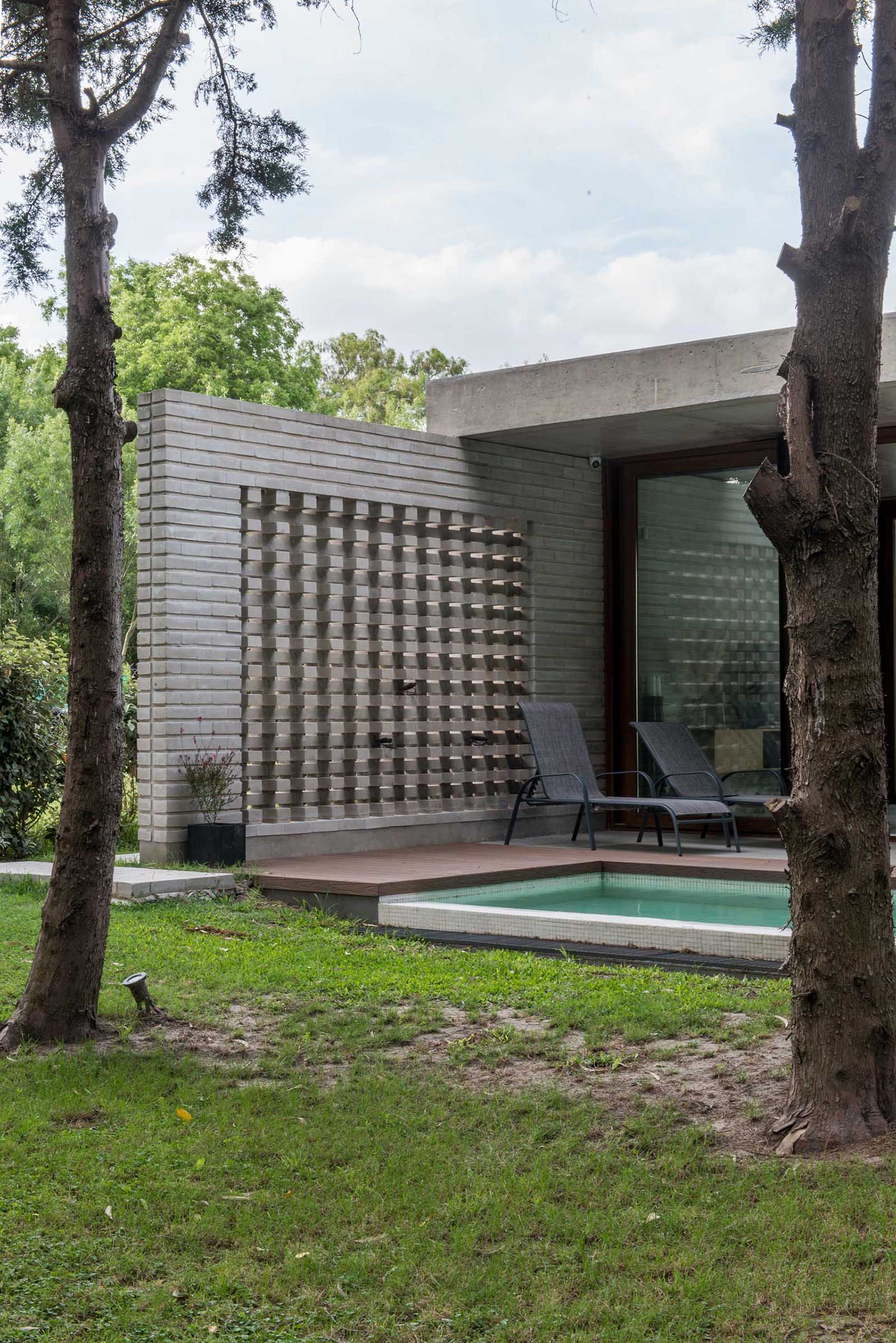 A modern concrete block wall that provides privacy.