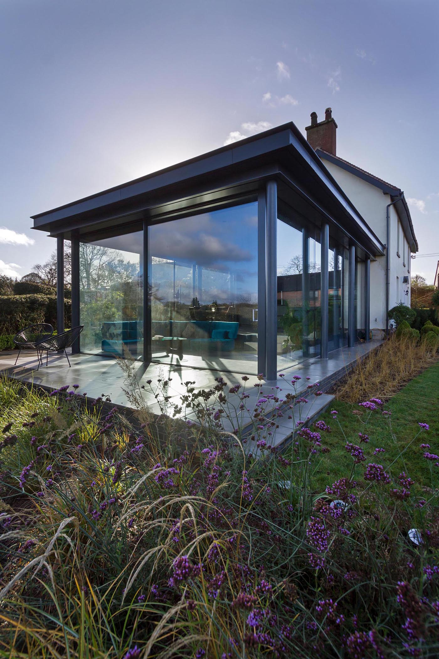 This fully glazed contemporary single storey extension is modern, light, easy to maintain, flexible, and has level access to the garden.