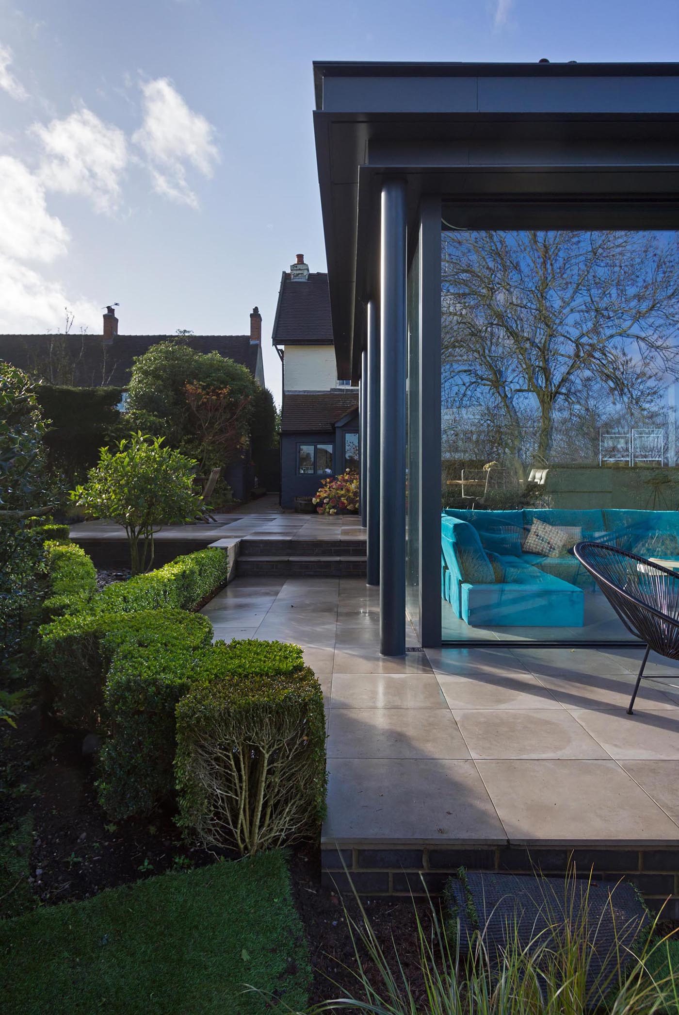 A modern extension with glass walls also has a wrap-around patio.