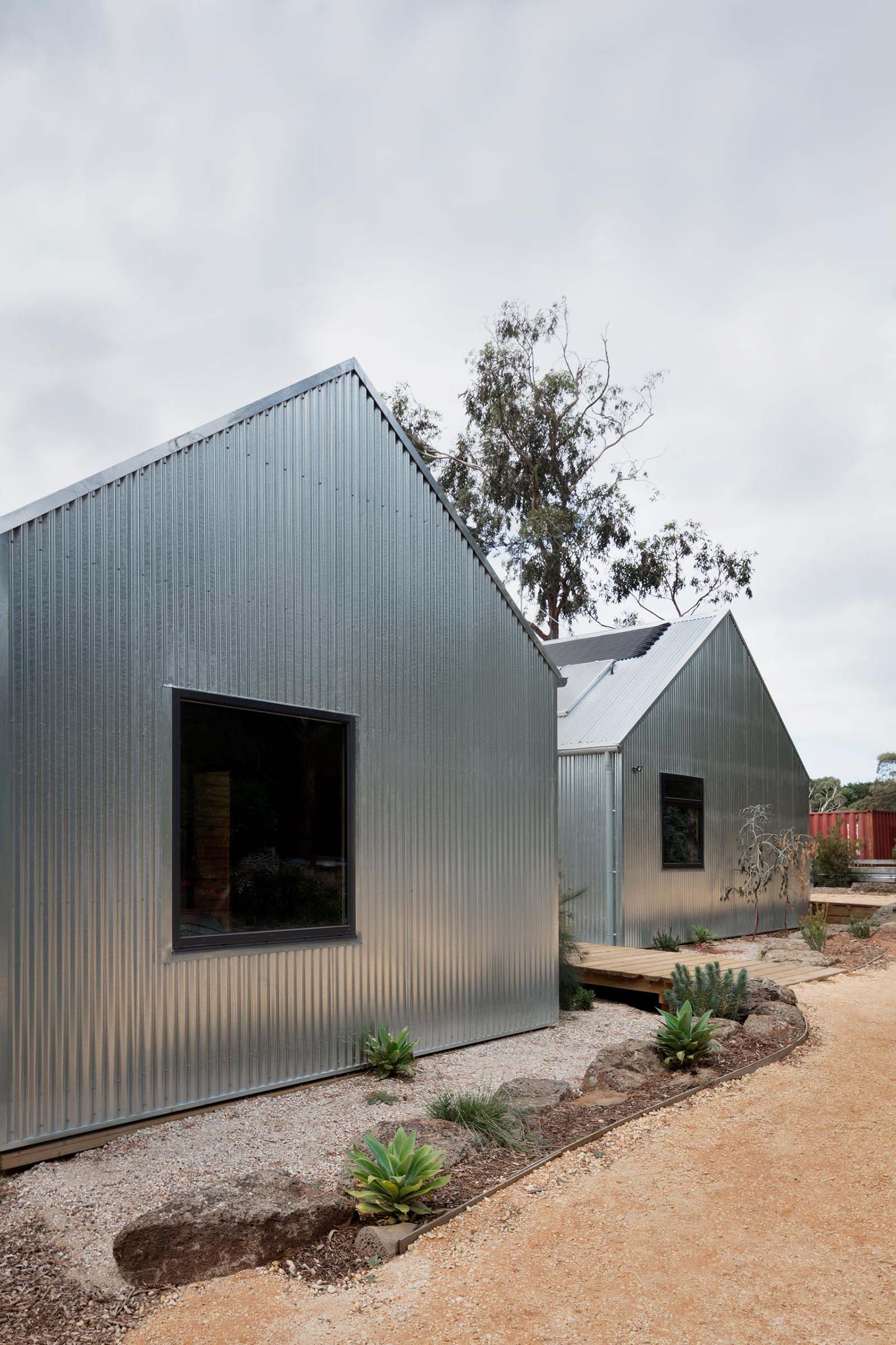 Corrugated steel siding, which covers the entire home, is designed change appearance as it ages, creating a dull finish.