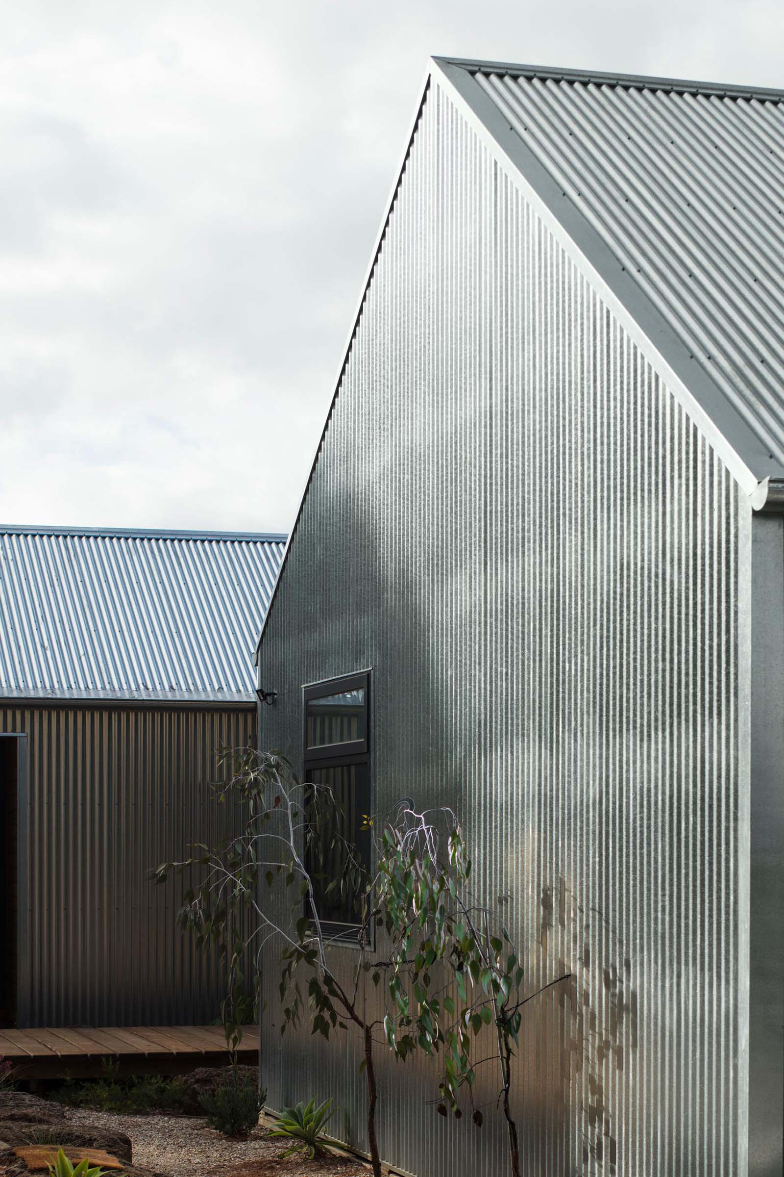 The hard exterior of corrugated galvanised steel sheeting, which covers this entire home, is designed change appearance as it ages, creating a dull finish.