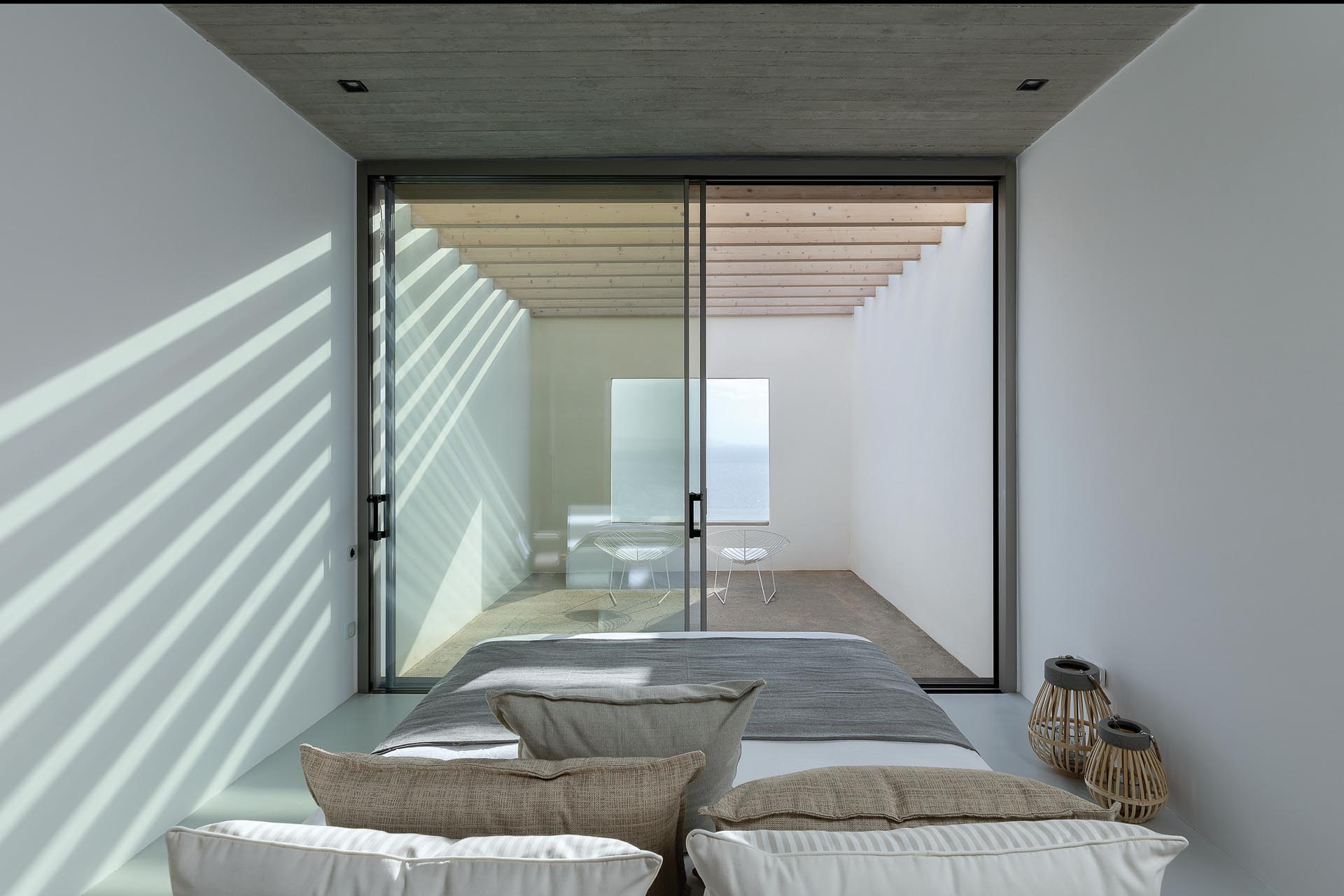 A modern bedroom with its own private outdoor patio.